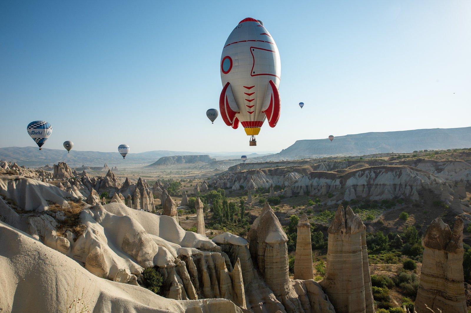 Hot air balloons fly above the Cappadocia region of Nevşehir province, central Turkey, Aug. 28, 2021. (AA Photo)