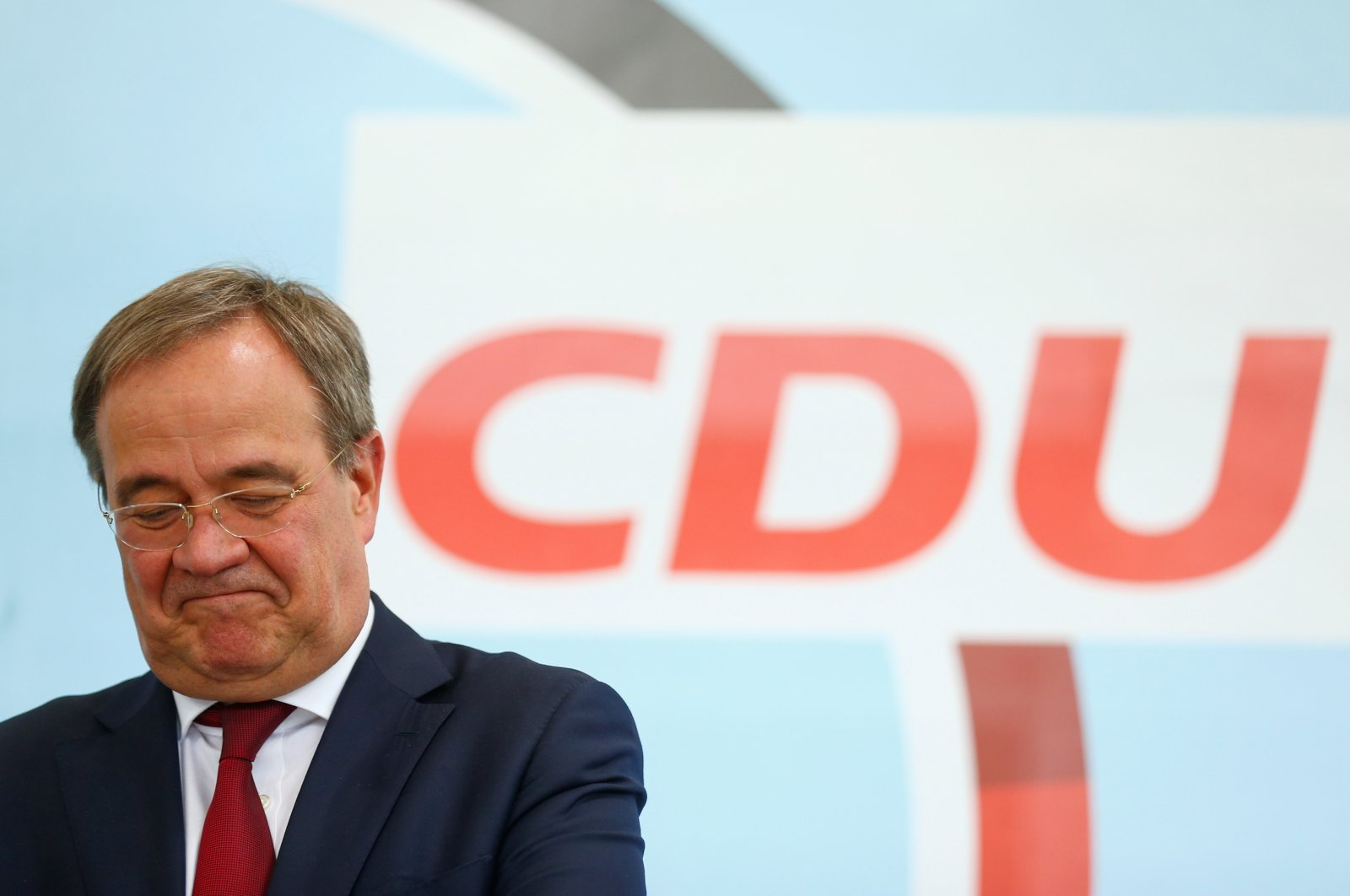 Armin Laschet, CDU/CSU candidate for Chancellor, CDU Federal Chairman and Minister President of North Rhine-Westphalia, attends an election rally in a beer garden in Korschenbroich, Germany, August 26, 2021. (Reuters Photo)