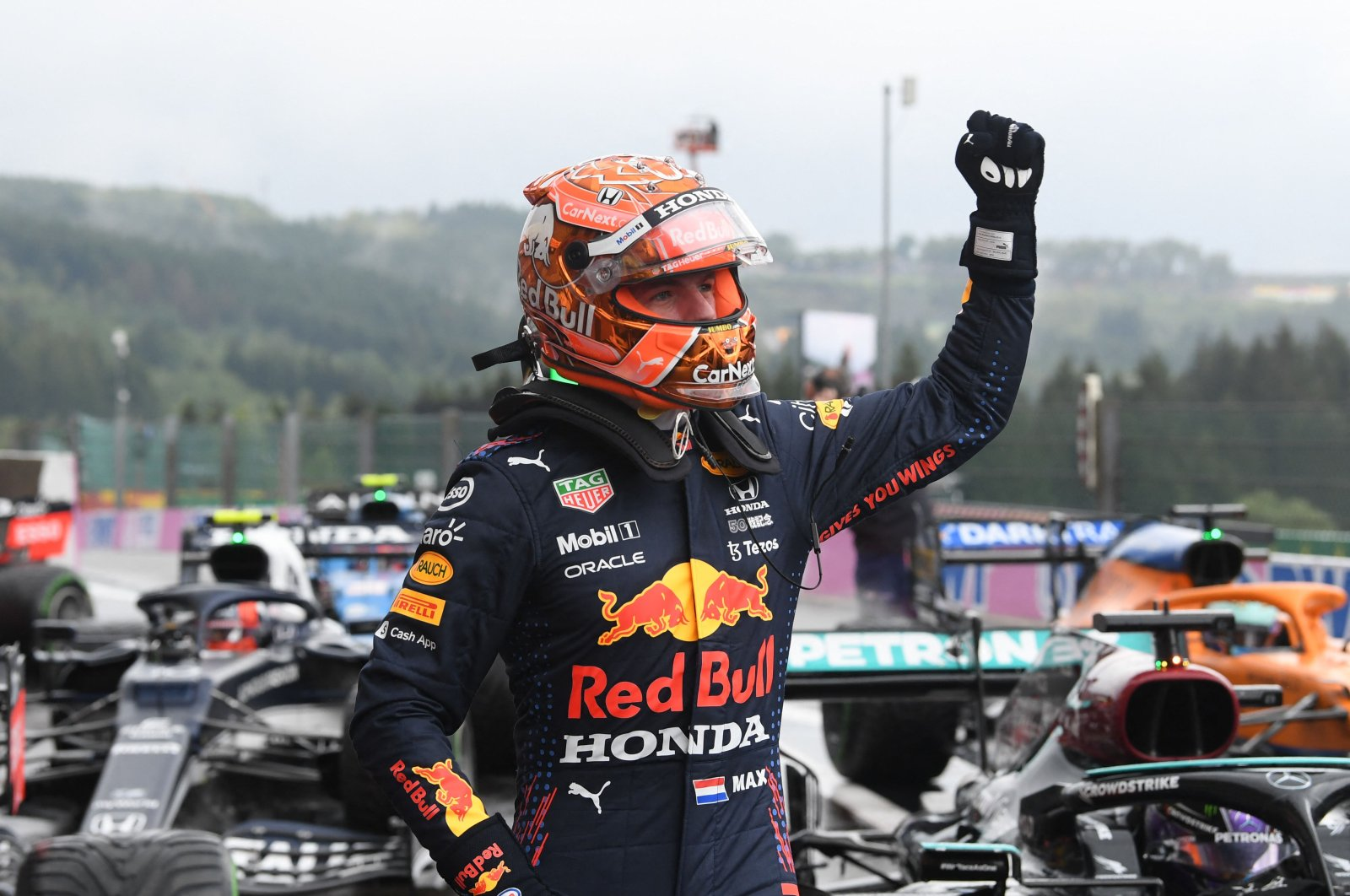 Red Bull's Dutch driver Max Verstappen celebrates taking pole position in the parc ferme after  the qualifying session of the Formula One Belgian Grand Prix at the Spa-Francorchamps circuit in Spa, Aug. 28, 2021. (AFP Photo)