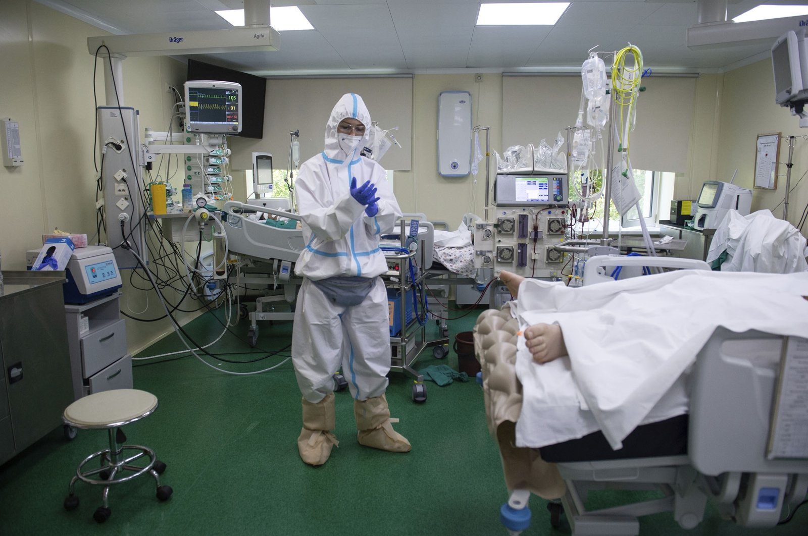 A medic wearing a special suit to protect against coronavirus prepares to treat a patient with coronavirus at the City hospital No. 52 for coronavirus patients in Moscow, Russia, July 13, 2021. (AP Photo)