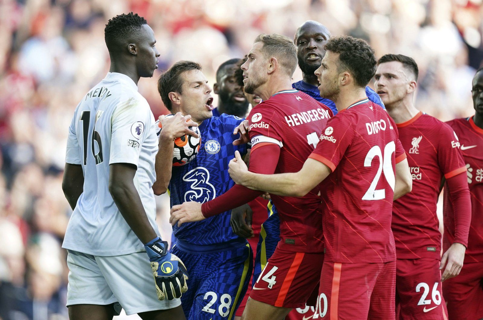 Chelsea's Cesar Azpilicueta (C-L), and Liverpool's Jordan Henderson (C-R), clash following Liverpool's equalizer during the English Premier League match between Liverpool and Chelsea at Anfield, Liverpool, U.K., Aug. 28, 2021. (AP Photo)