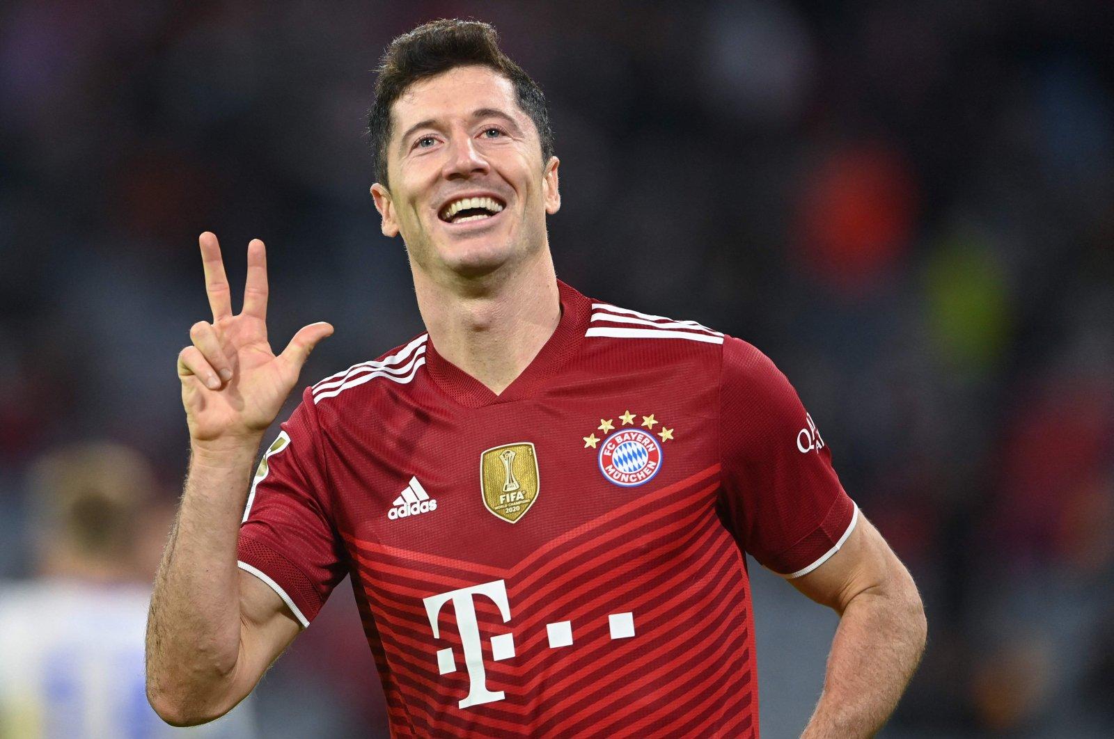 Bayern Munich's Polish forward Robert Lewandowski celebrates scoring his hat trick during the Bundesliga football match between FC Bayern Munich and Hertha BSC Berlin in Munich, southern Germany, Aug. 28, 2021. (AFP Photo)