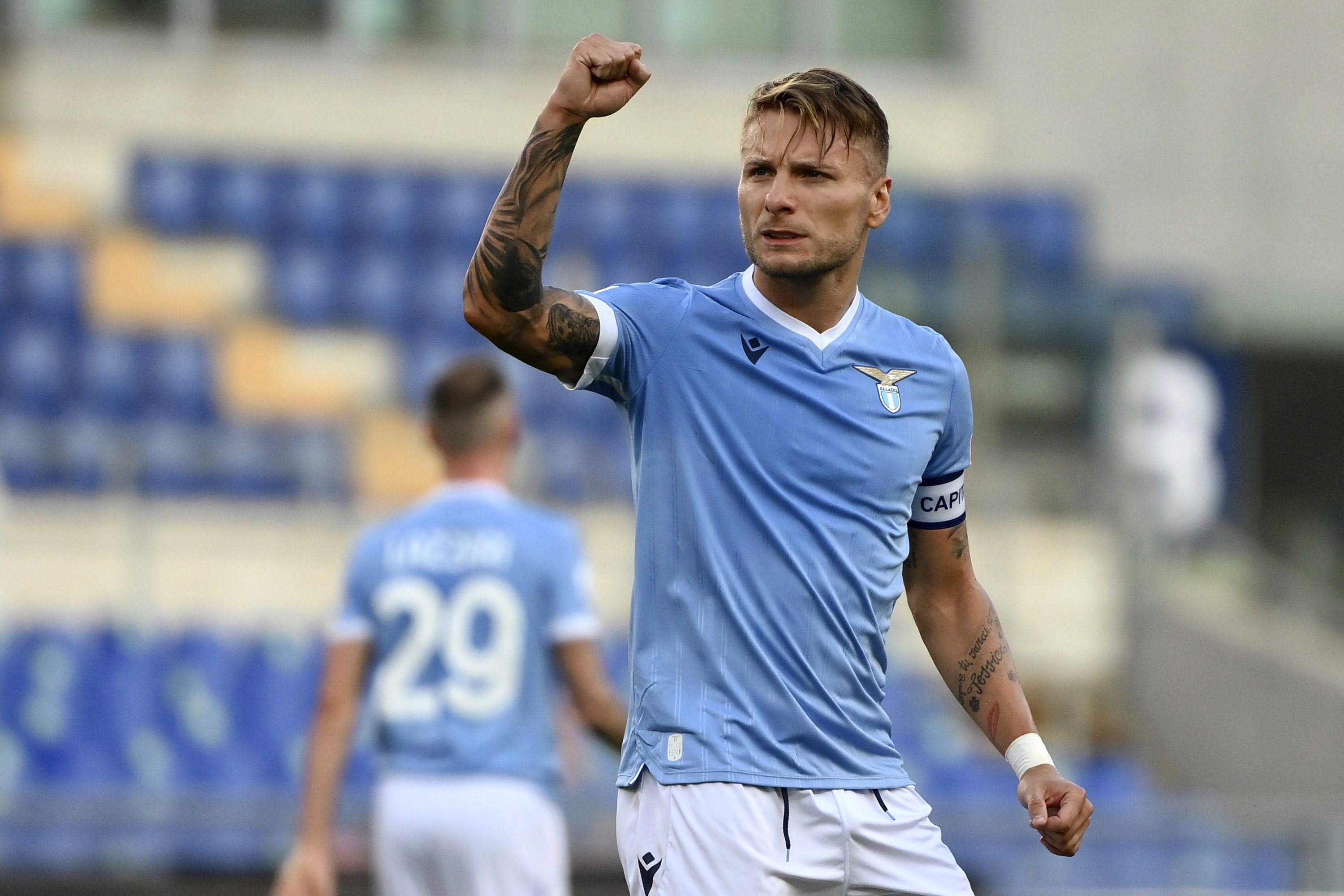 Lazio's Ciro Immobile celebrates after scoring his side's opening goal during a Serie A match against Spezia, at the Rome Olympic stadium, Saturday, Aug. 28, 2021. (AP Photo)