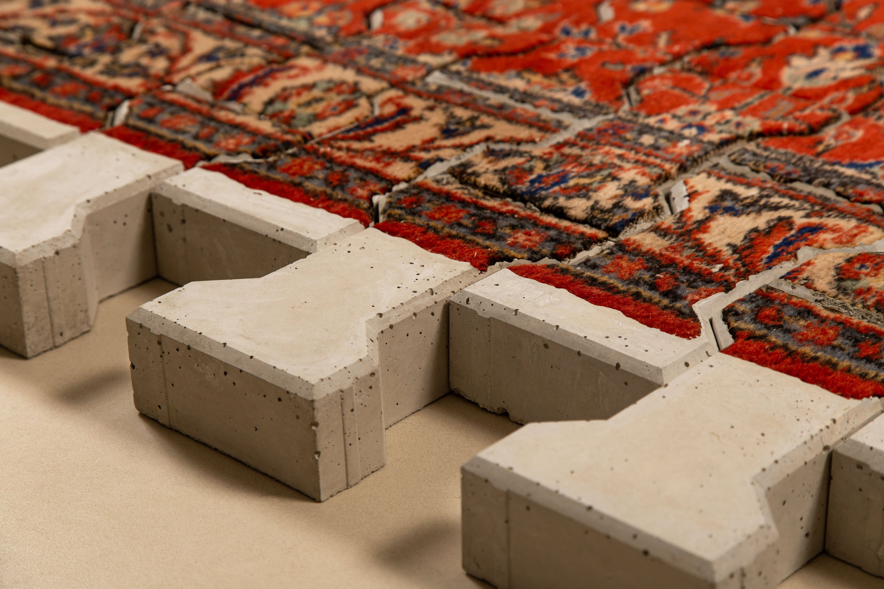 Ramazan Can, 'The Pain of Existence,' 2021, concrete and carpet, 130 pieces, each 6 by 13.5 by 22.5 centimeters. (Courtesy of Anna Laudel)