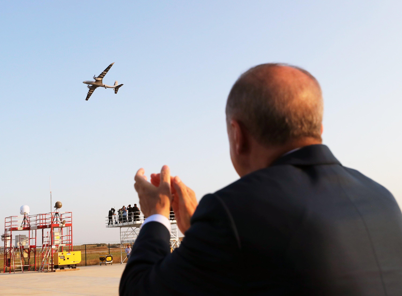 President Recep Tayyip Erdoğan applauds as an Akıncı UCAV conducts a flight above the Akıncı Flight Training and Test Center in the Çorlu district of Tekirdağ province, northwestern Turkey, Aug. 29, 2021. (DHA Photo)
