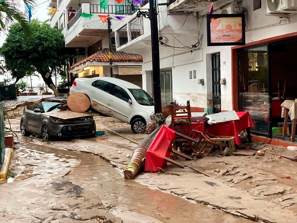 Damaged cars are pictured on a flooded street after Hurricane Nora pounds Mexico's coast with heavy rains and strong winds in Puerto Vallarta, in Jalisco state, Mexico, Aug. 29, 2021. (REUTERS Photo)