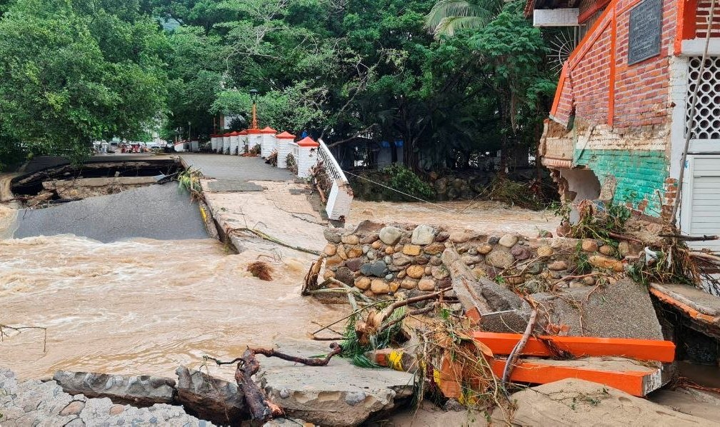 A general view shows a flooded and damage street after Hurricane Nora pounds Mexico's coast with heavy rains and strong winds in Puerto Vallarta, Jalisco state, Mexico, Aug. 29, 2021. (REUTERS Photo)