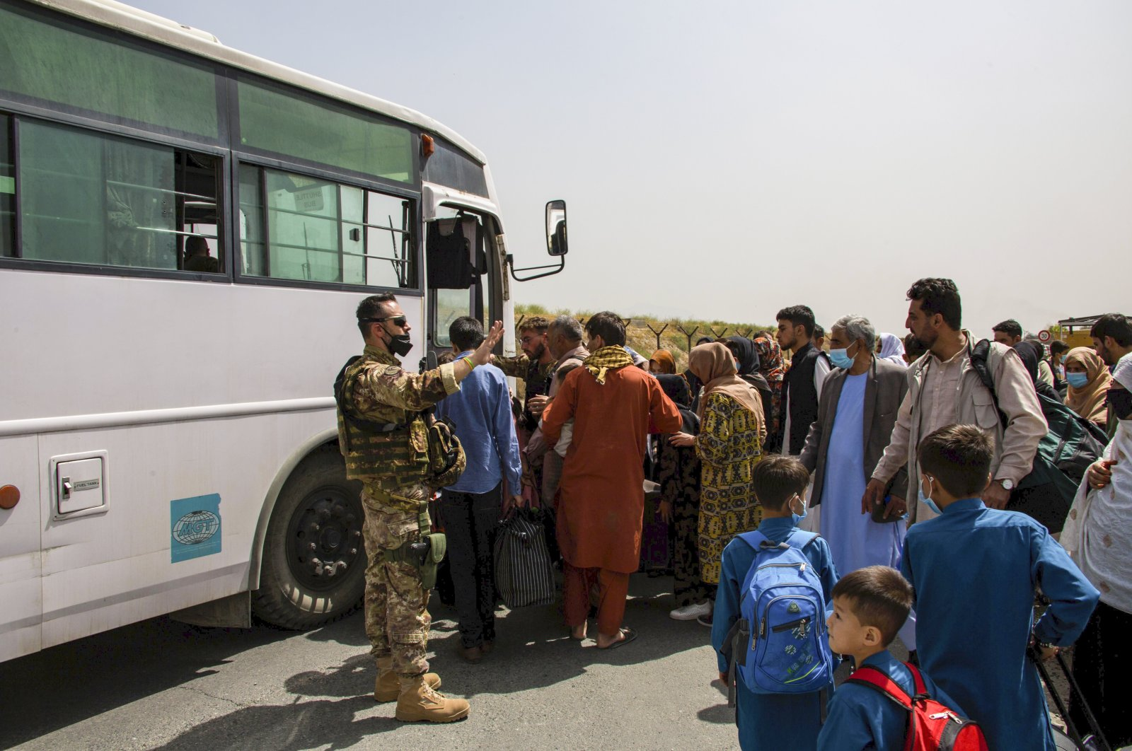 In this image provided by the U.S. Marine Corps, German military members process evacuees at Hamid Karzai International Airport in Kabul, Afghanistan, Aug. 28, 2021. (AP Photo)