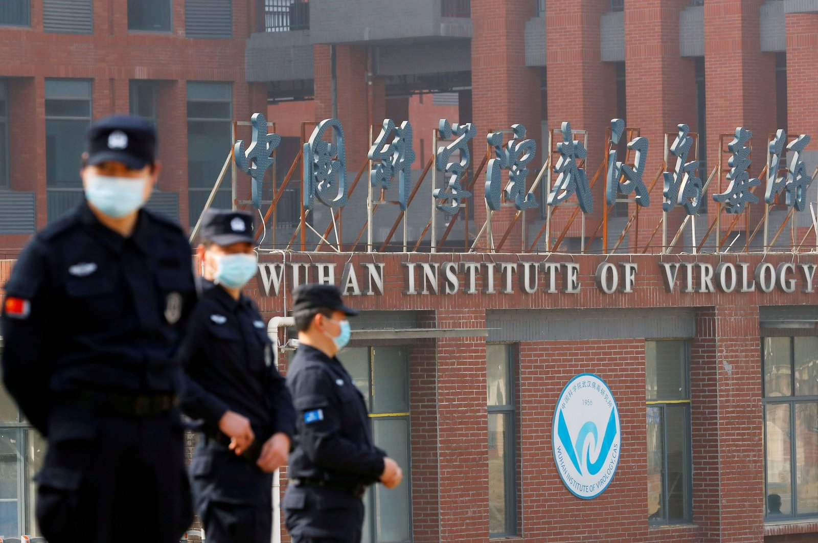 Security personnel keep watch outside the Wuhan Institute of Virology during the visit by the World Health Organization (WHO) team tasked with investigating the origins of COVID-19, in Wuhan, Hubei province, China Feb. 3, 2021. (Reuters Photo)
