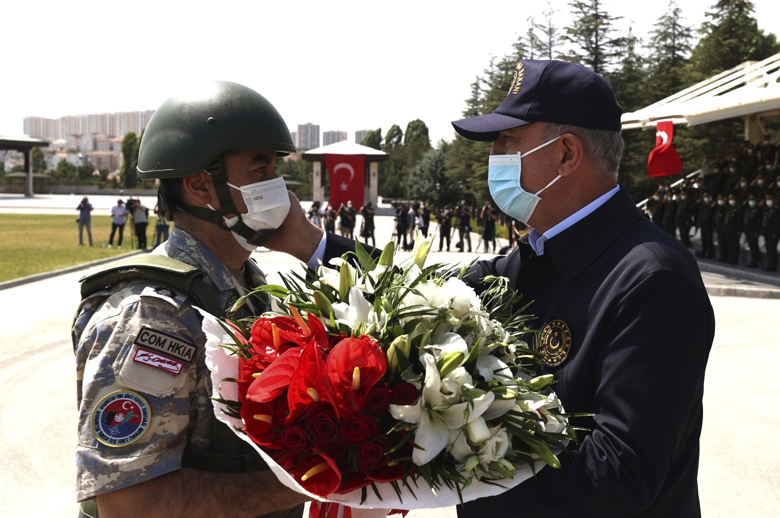 Turkey's Defense Minister Hulusi Akar welcomes an army officer who returned from Kabul, Afghanistan, during a ceremony at Esenboğa Airport, Ankara, Turkey, Aug. 28, 2021. (AP Photo)