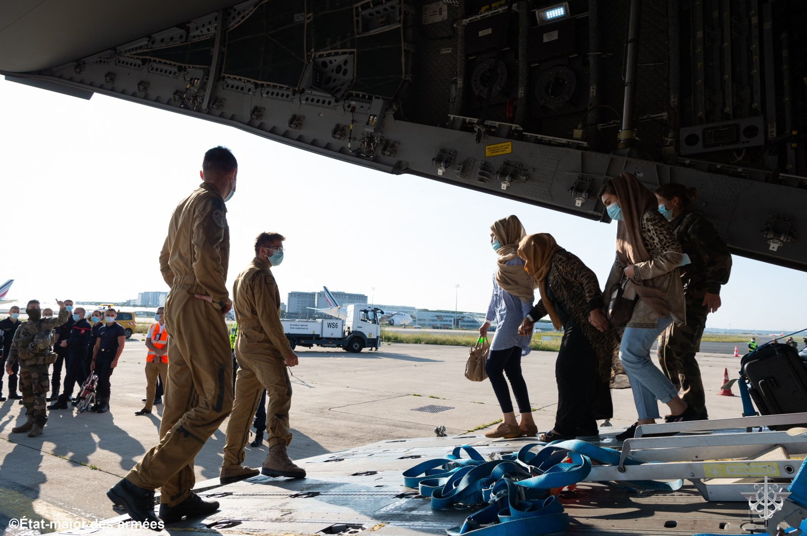 """People disembarking from a French Airforce 400M Atlas aircraft after being evacuated from Afghanistan as part of the operation """"Apagan"""", at the Roissy-Charles de Gaulle airport, Paris, France,  August 25, 2021. (French Etat-Major des Armees via AFP)"""