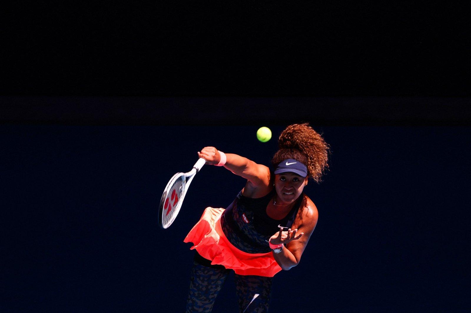 Japan's Naomi Osaka serves against U.S.' Serena Williams during the Australian Open women's singles semifinal match in Melbourne, Australia, Feb. 18, 2021. (AFP Photo)