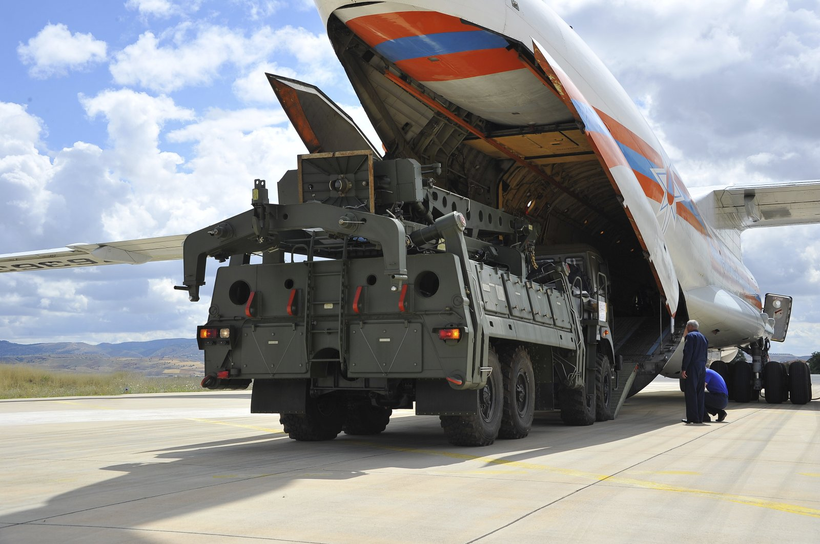 Military vehicles and equipment, parts of the S-400 air defense systems, are unloaded from a Russian transport aircraft, at Mürted military airport in Ankara, Turkey, July 12, 2019. (Turkish Defense Ministry via AP)