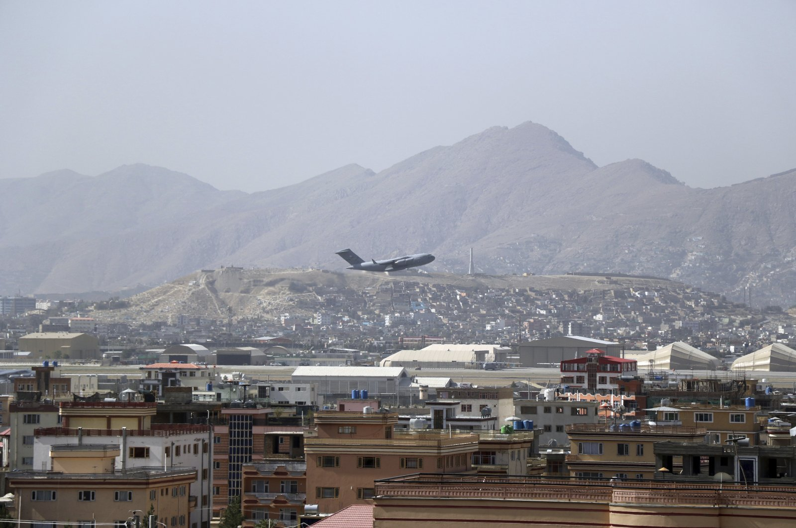 A U.S. military aircraft takes off from Hamid Karzai International Airport in Kabul, Afghanistan, Aug. 28, 2021. (AP Photo)