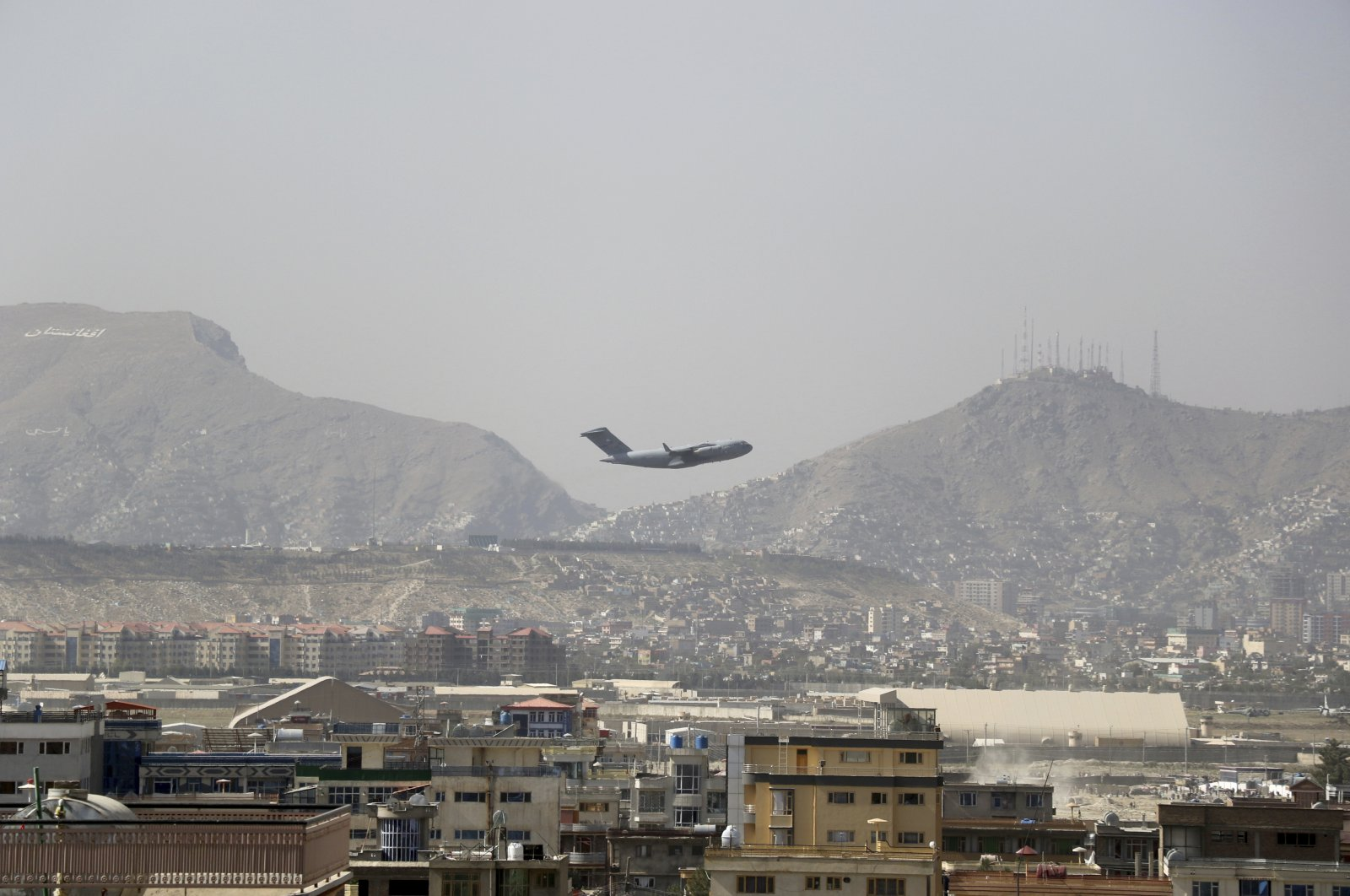 U.S military aircraft takes off at the Hamid Karzai International Airport in Kabul, Afghanistan, Saturday, Aug. 28, 2021. (AP Photo)