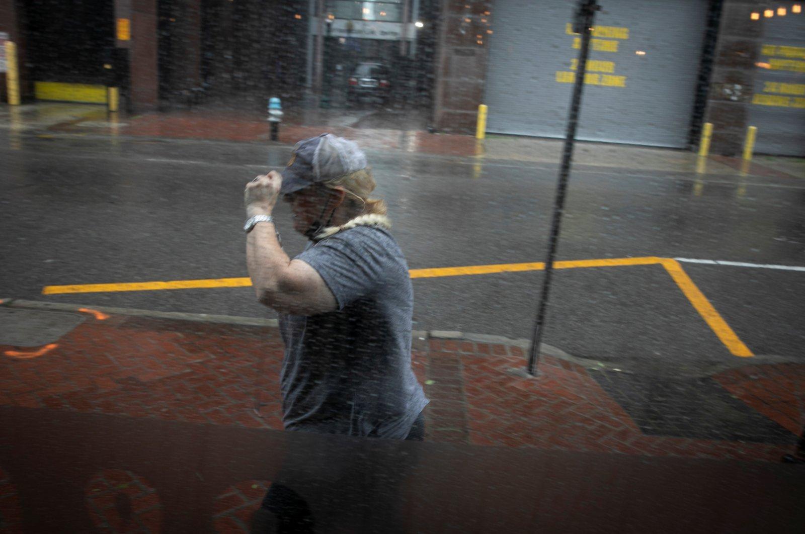 A woman walks in the rain as Hurricane Ida makes landfall in Louisiana, in New Orleans, Louisiana, U.S. Aug. 29, 2021. (REUTERS)