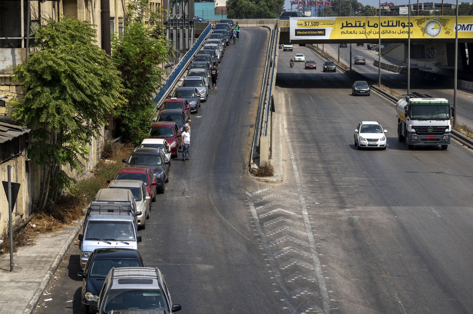 Drivers wait in a long line to get fuel at a gas station in Beirut, Lebanon, Aug. 28, 2021. (AP Photo)