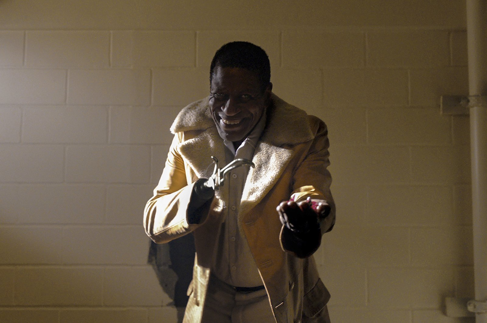 """Michael Hargrove as Sherman Fields gestures, in a scene from the film """"Candyman,"""" directed by Nia DaCosta. (Universal Pictures via AP)"""