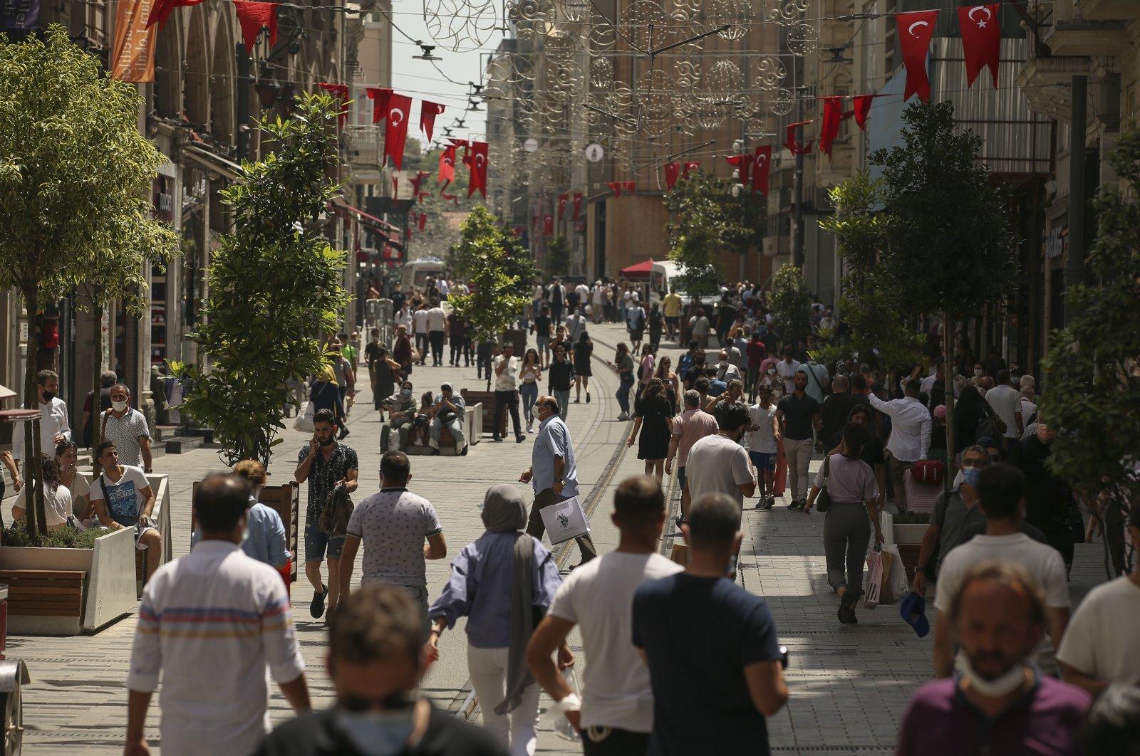 People walk on the busy shopping area of Istiklal Street, Beyoğlu, Istanbul, Turkey, July 1, 2021. (AP Photo)