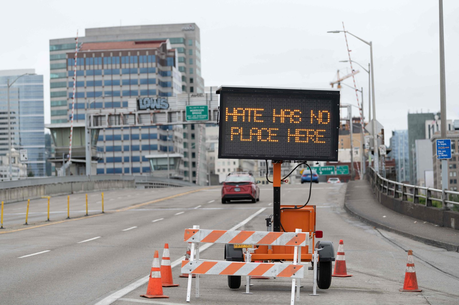 A traffic sign displays a message on the Morrison Bridge ahead of opposing rallies between far-right groups and anti-fascist activists in Portland, Oregon, U.S., Aug. 22, 2021. (AFP Photo)