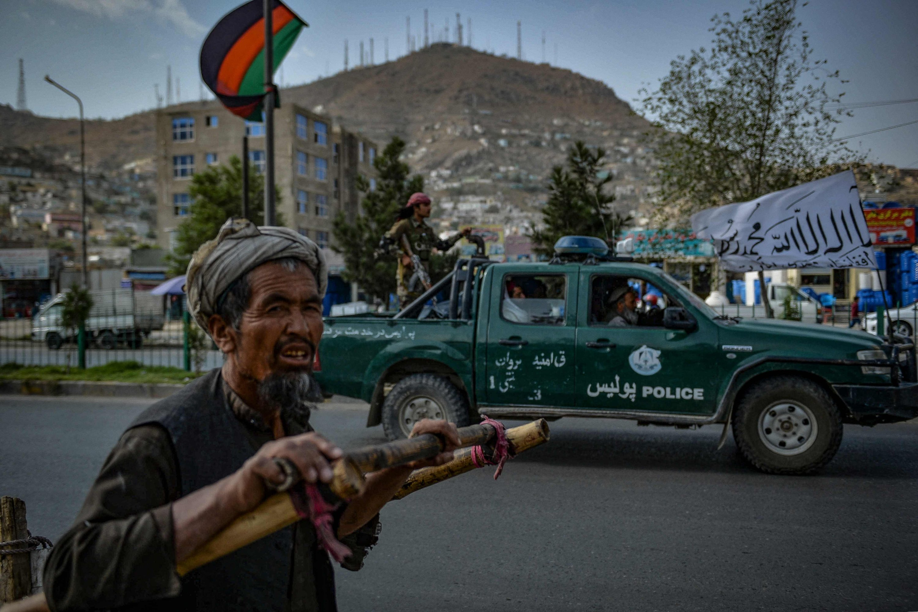 Taliban fighters patrol along a street in Kabul, Afghanistan, Aug. 31, 2021. (AFP Photo)