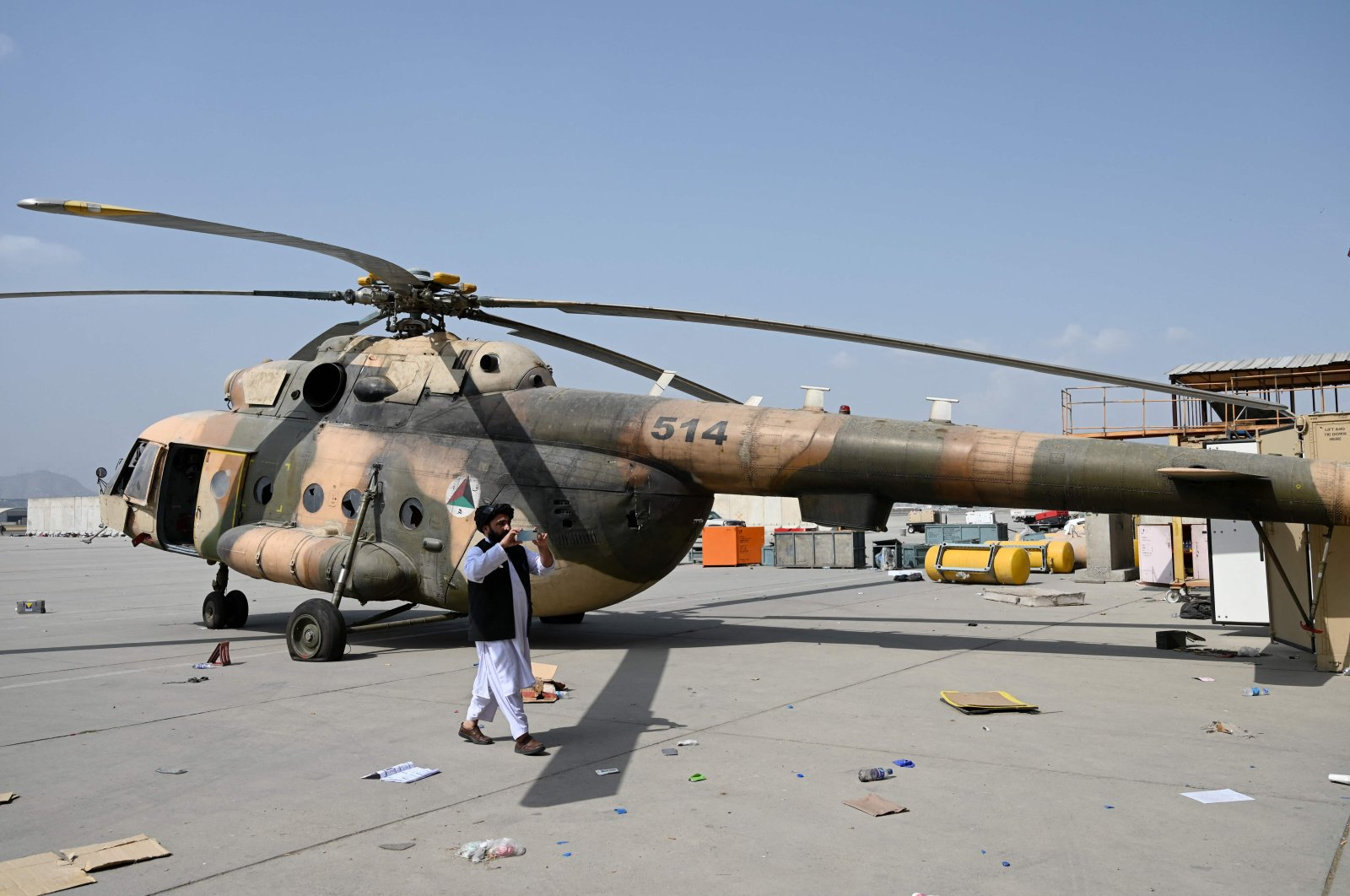 A Taliban member takes photos with a mobile phone at the airport in Kabul, Afghanistan, Aug. 31, 2021. (AFP Photo)