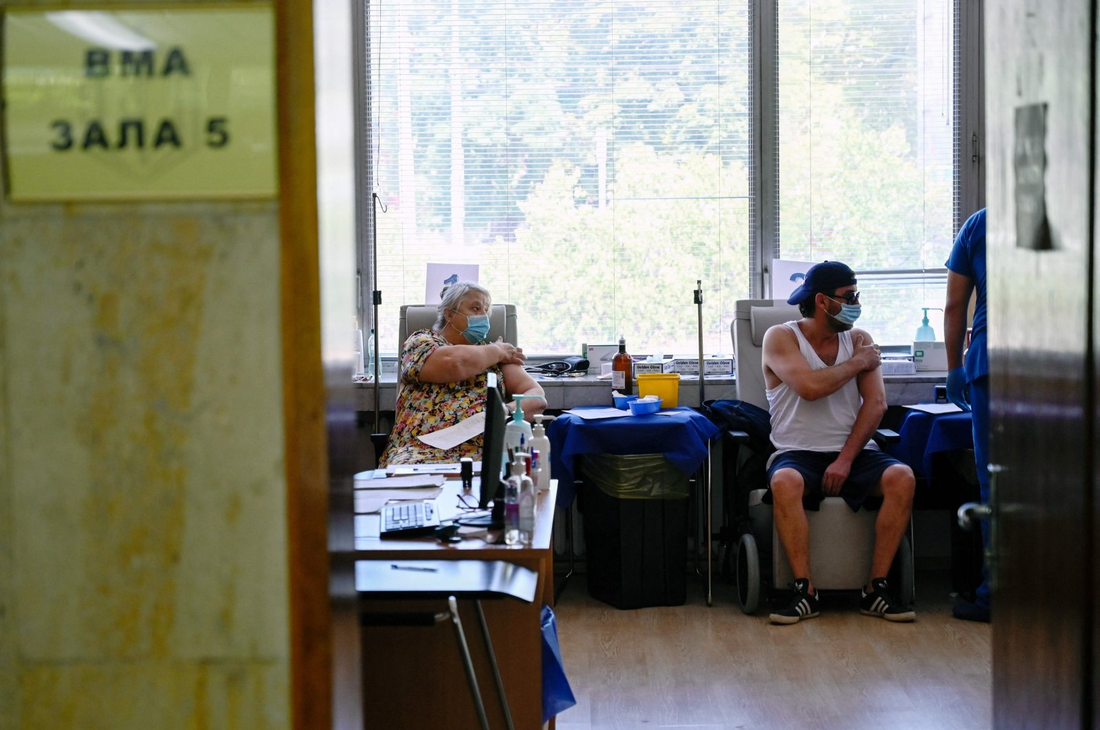 Patients pictured after receiving their dose of a COVID-19 vaccine in Sofia, Bulgaria, Aug. 6, 2021. (AFP Photo)