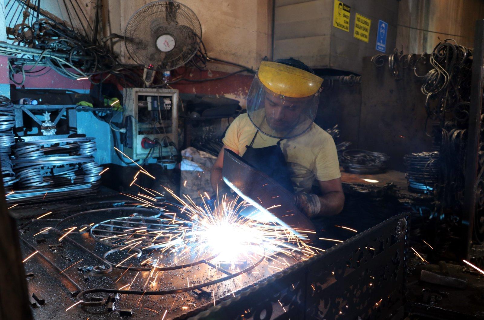 A worker is seen in a workshop in Gaziantep province, southeastern Turkey, Aug. 28, 2021. (AA Photo)
