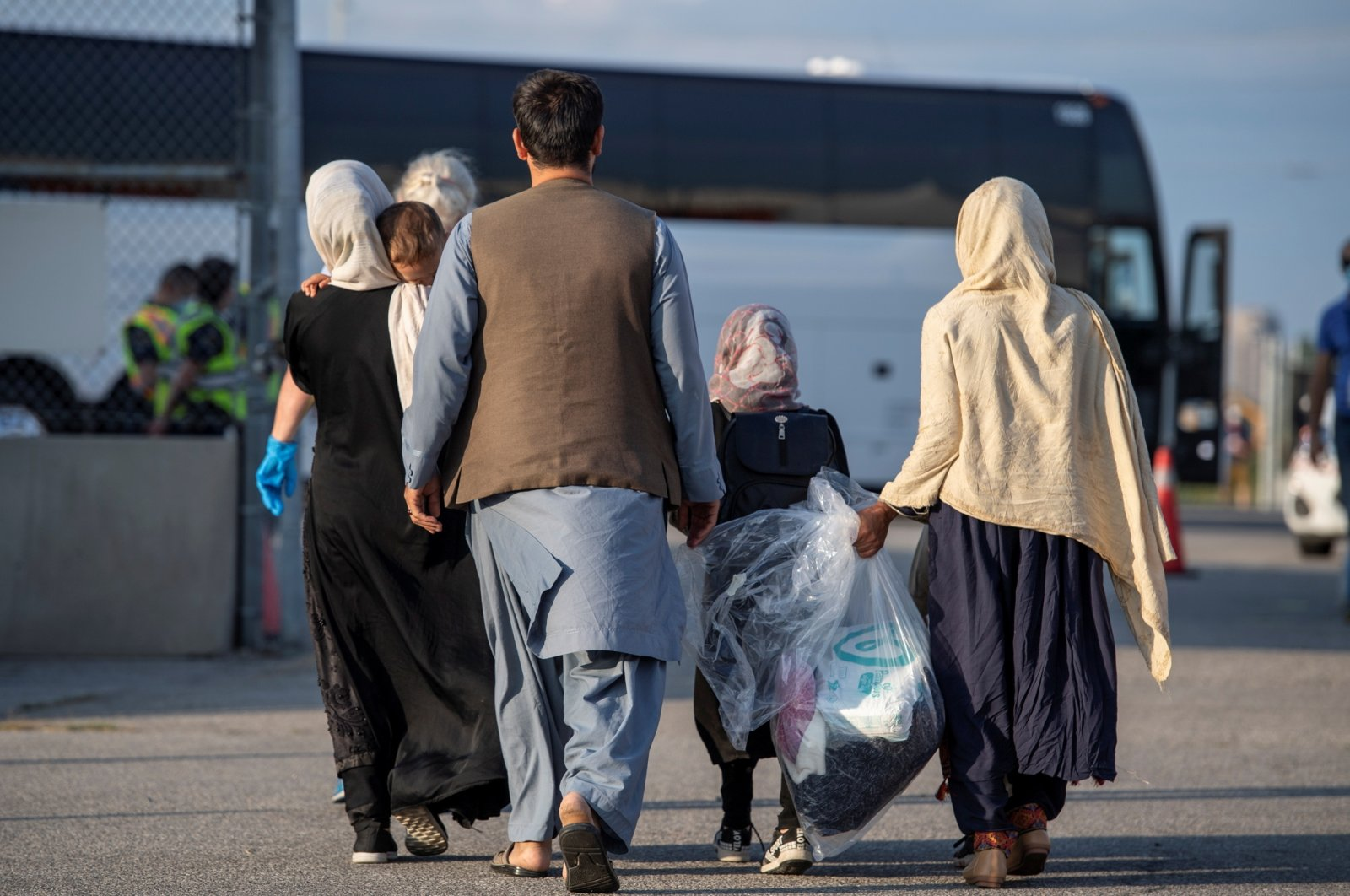 Afghan refugees who supported Canada's mission in Afghanistan arrive at Toronto Pearson International Airport, Toronto, Canada, on Aug. 24, 2021. (Canadian Armed Forces Handout via Reuters)