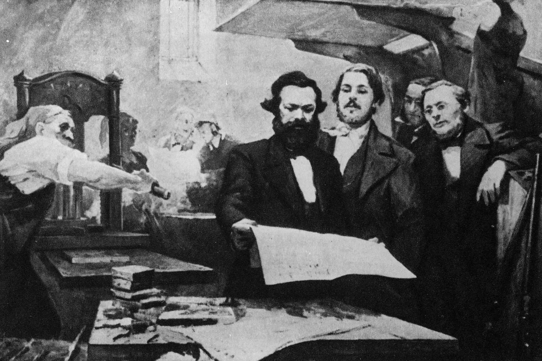 Karl Marx and Friedrich Engels in the printing house of the 'Neue Rheinische Zeitung' (New Rhenish Newspaper). (Getty Images)