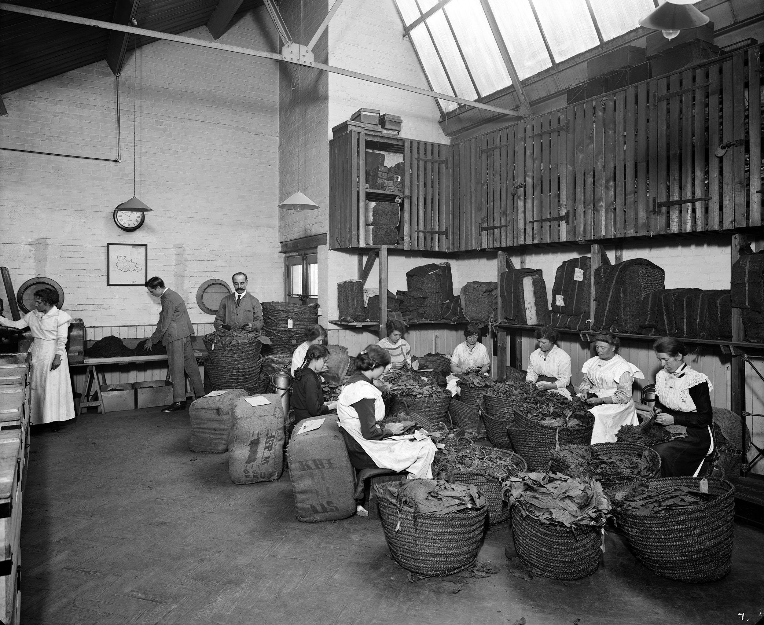 Women leaf-picking tobacco in the Turkish leaf room, Teafani & Co Works, Brixton, London, U.K., 1916. (Getty Images)