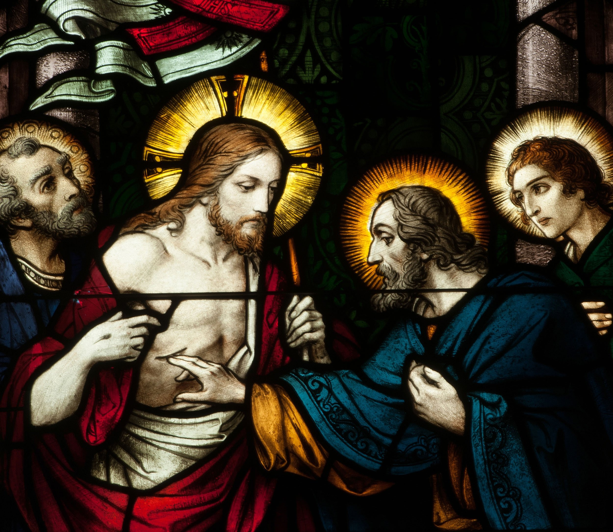 Stained glass window depicting the Apostle Thomas putting his hand in the side of Jesus,Connellsville,Pennsylvania, U.S., May 1, 2019. (Shutterstock Photo)