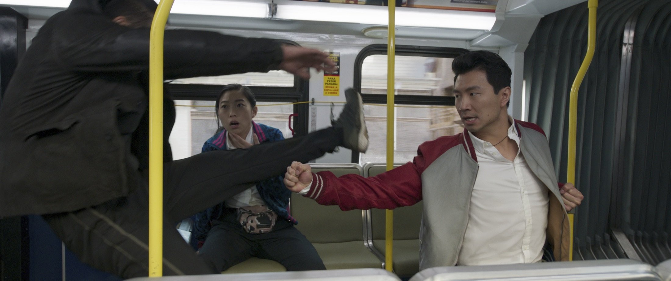 """Awkwafina (C) andSimu Liu (R), in a scene from the film """"Shang-Chi and the Legend of the Ten Rings."""" (Marvel Studios via AP)"""