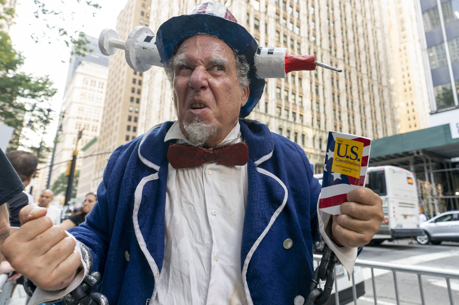 A protester wears an Uncle Sam outfit at a demonstration against COVID-19 vaccination mandates, in New York, U.S, Aug. 25, 2021. (AP Photo)