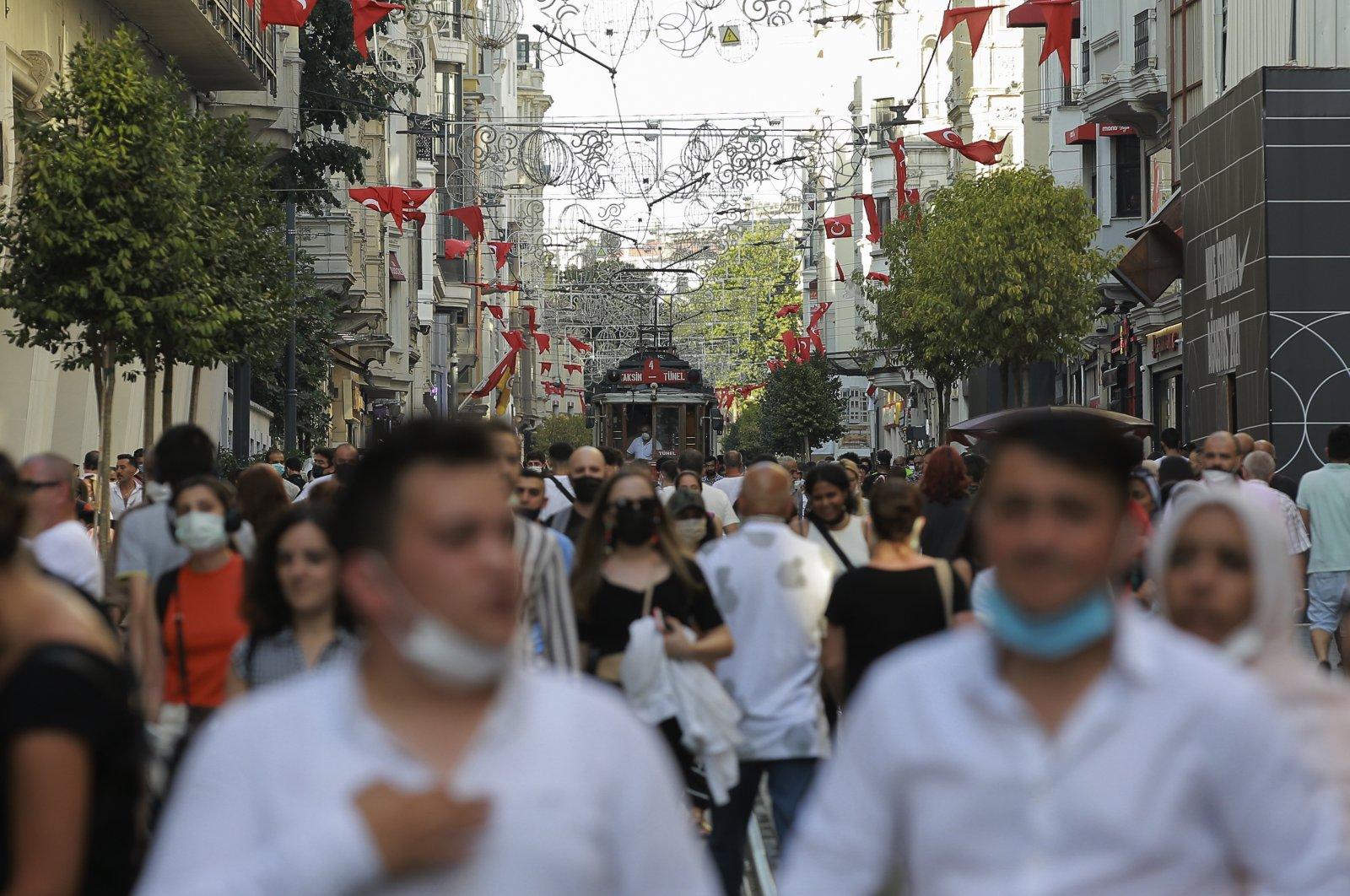 People walk along Istiklal Street, the main shopping street in Istanbul, Turkey, July 27, 2021. (AP Photo)