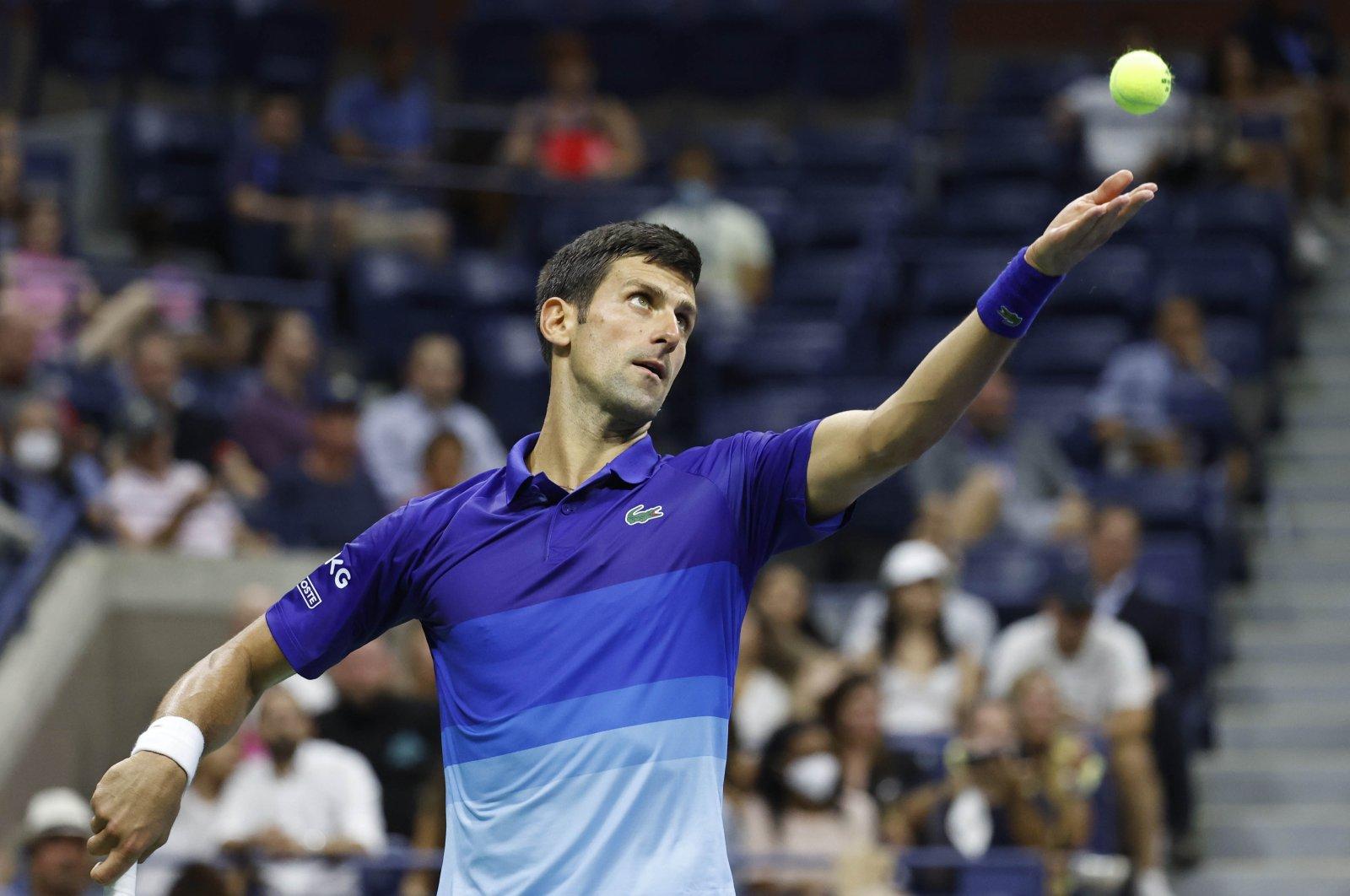 Serbia's Novak Djokovic serves against Denmark's Holger Vitus Nodskov Rune in their U.S. Open first-round match, New York, U.S., Aug. 31, 2021. (Reuters Photo)