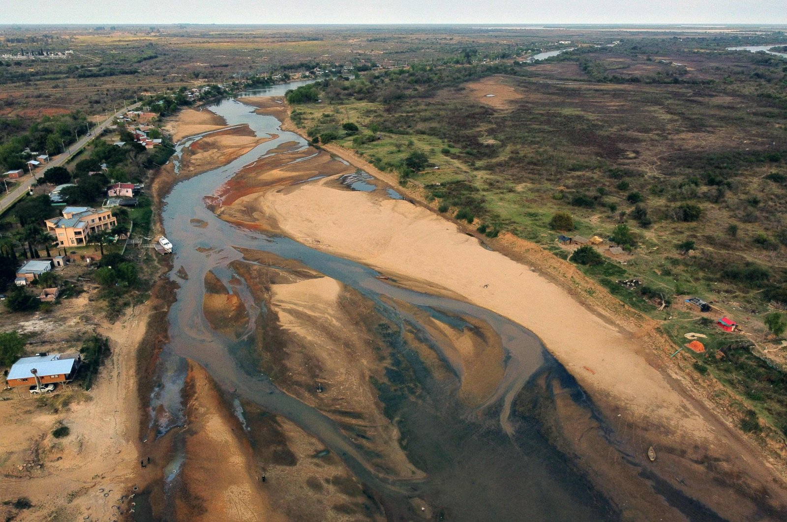 Aerial view of an almost dry arm of the Parana River during a historic downspout in Goya, Corrientes, Argentina, Aug. 21, 2021. (AFP Photo)