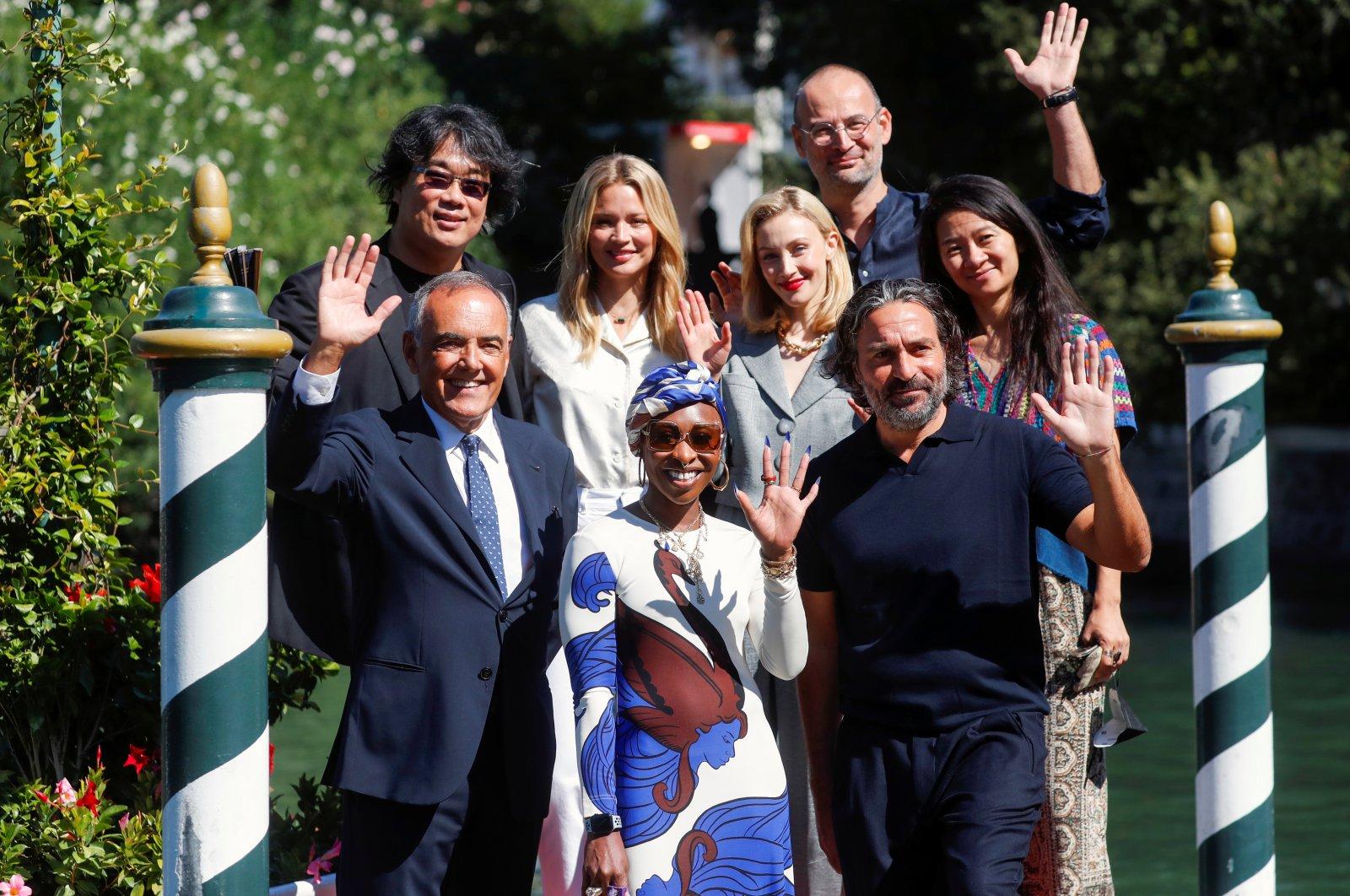 Members of the Venice Film Festival Jury, Bong Joon-ho, Saverio Costanzo, Virginie Efira, Cynthia Erivo, Sarah Gadon, Alexander Nanau, Chloe Zhao and Alberto Barbera pose for a photo, in Venice, Italy, Sept. 1, 2021. (Reuters Photo)