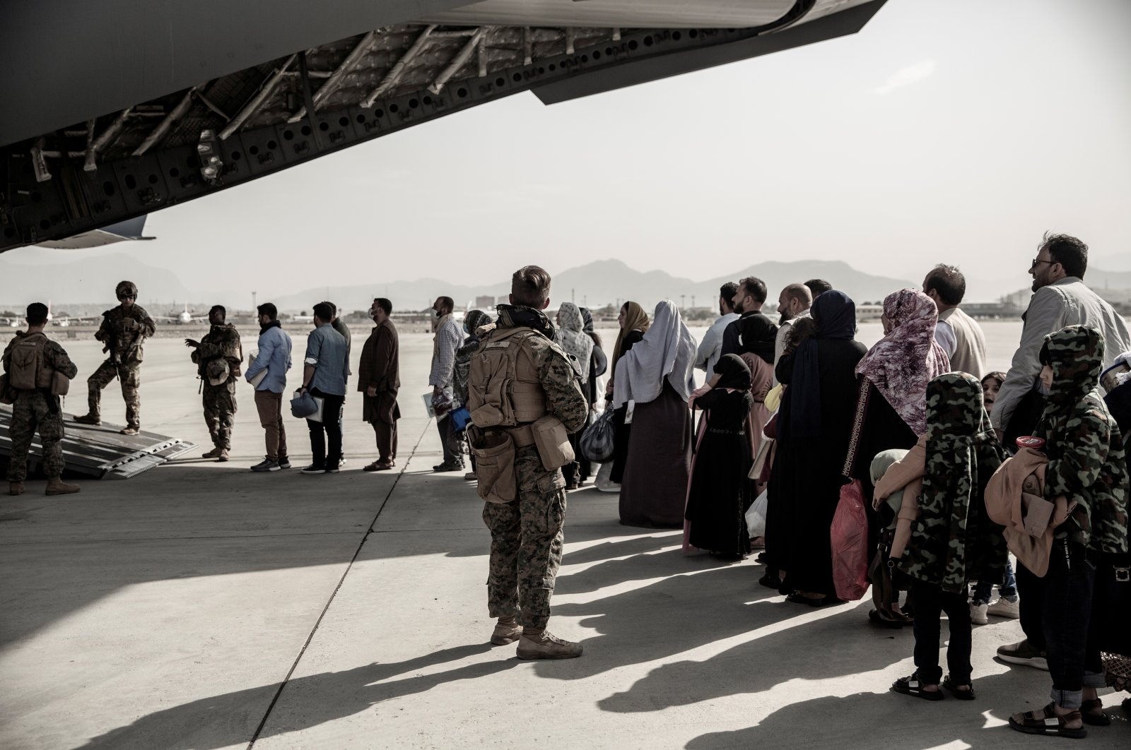 Evacuees wait to board a Boeing C-17 Globemaster III during an evacuation at Hamid Karzai International Airport in Kabul, Afghanistan August 30, 2021. (REUTERS Photo)