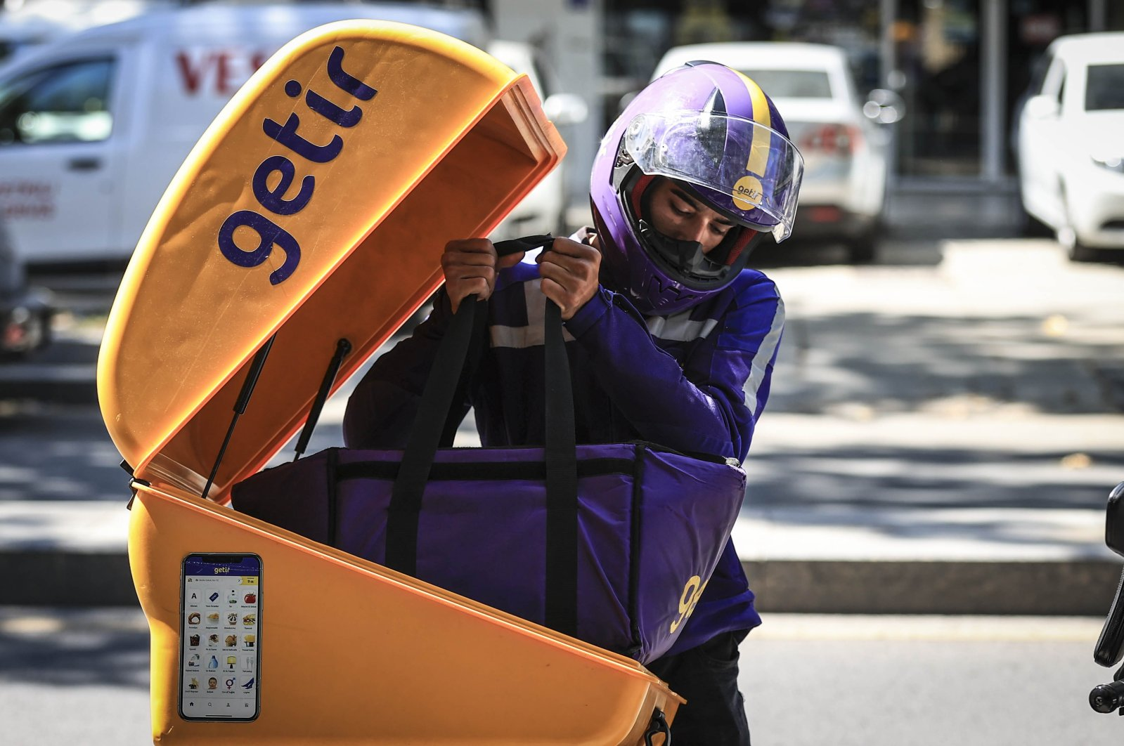 A Getir employee takes out groceries from his motorcycle, Aug. 8, 2021. (AA Photo)