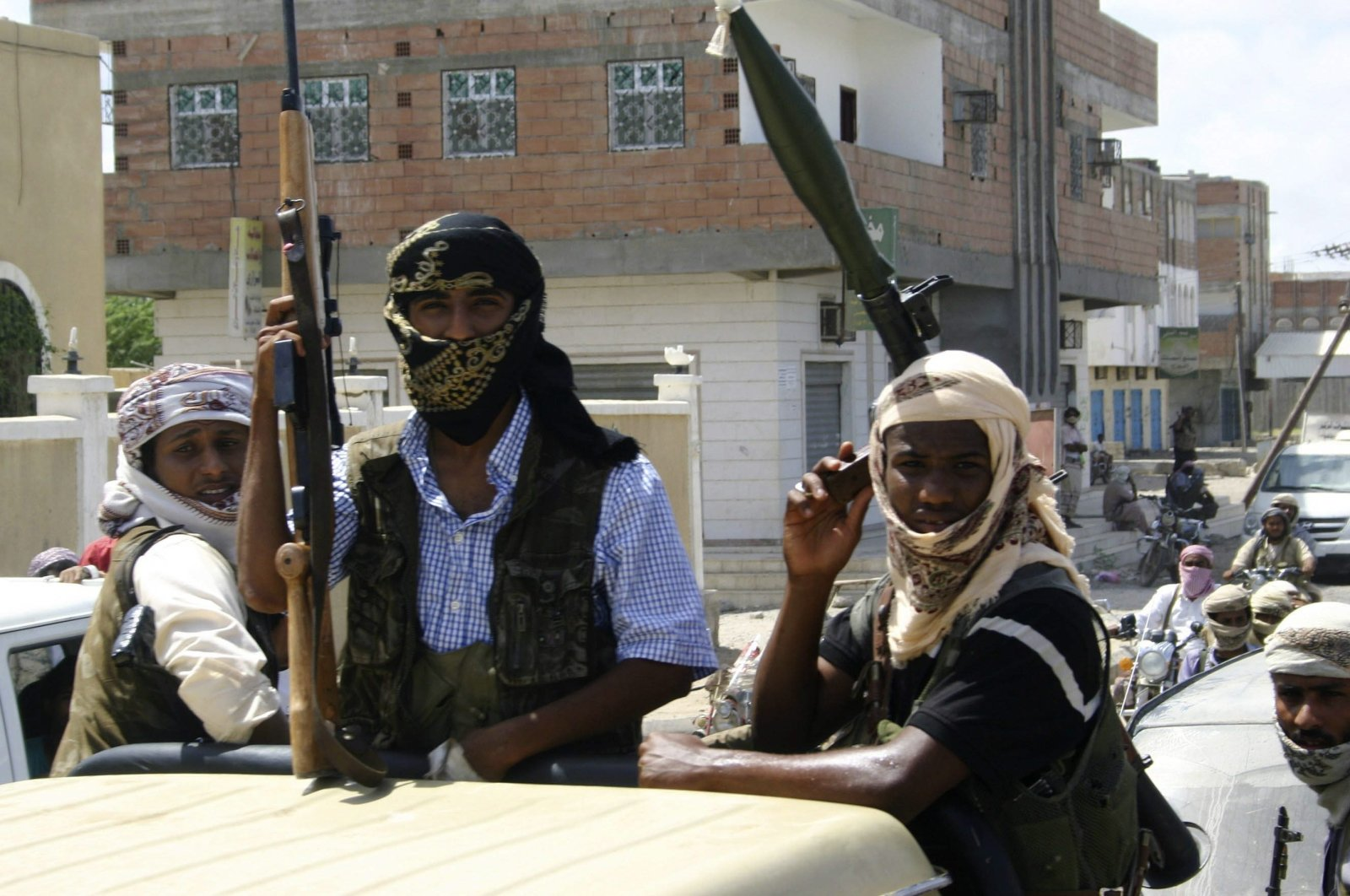 Members of Ansar al-Sharia, an al-Qaida affiliated group, carry their weapons as they ride on a truck in the town of Jaar, southern Yemen, April 28, 2012. (Reuters Photo)