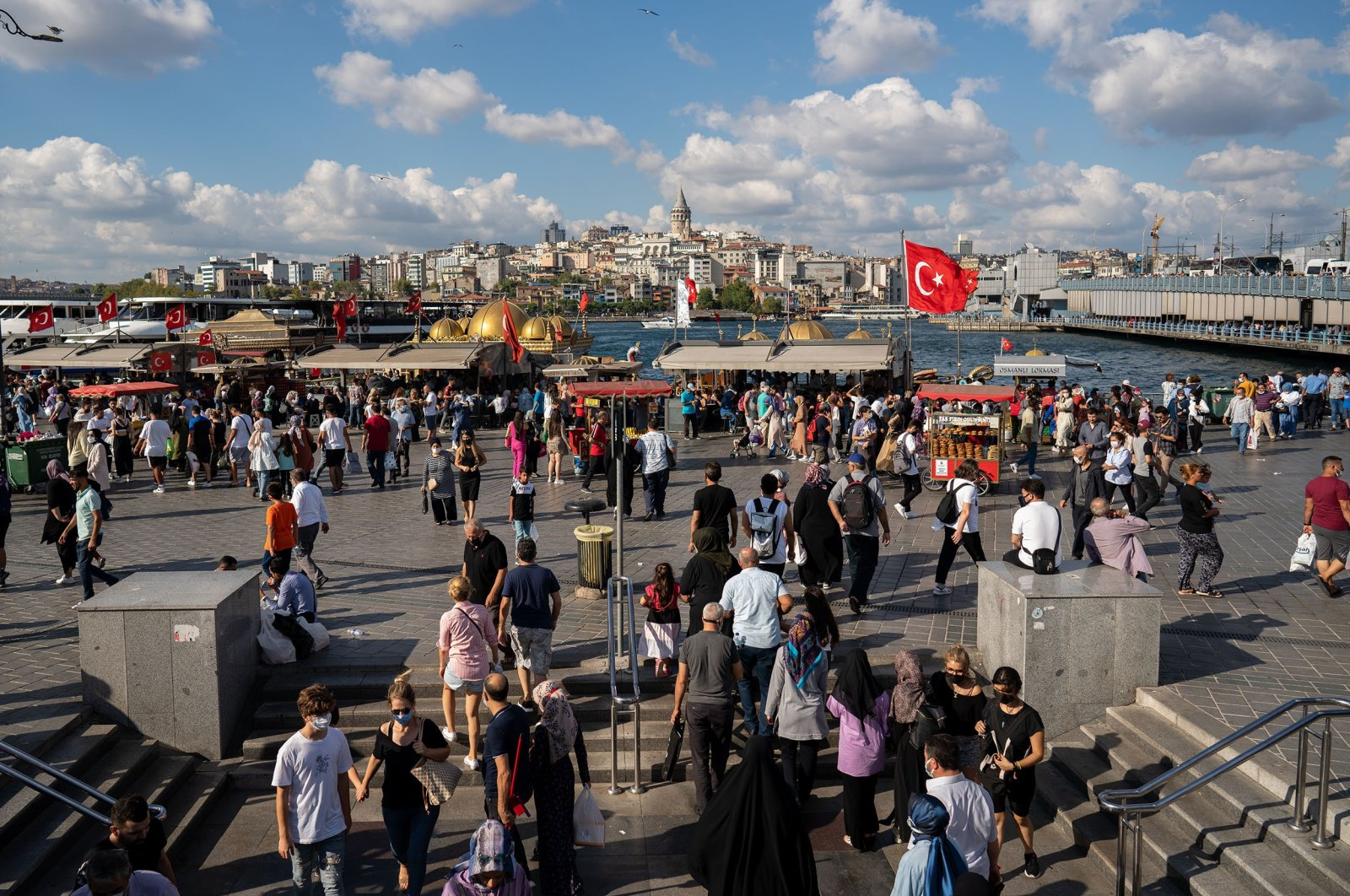 People are seen in the busy shopping district of Eminönü, Istanbul, Turkey, Aug. 21, 2021. (Reuters Photo)