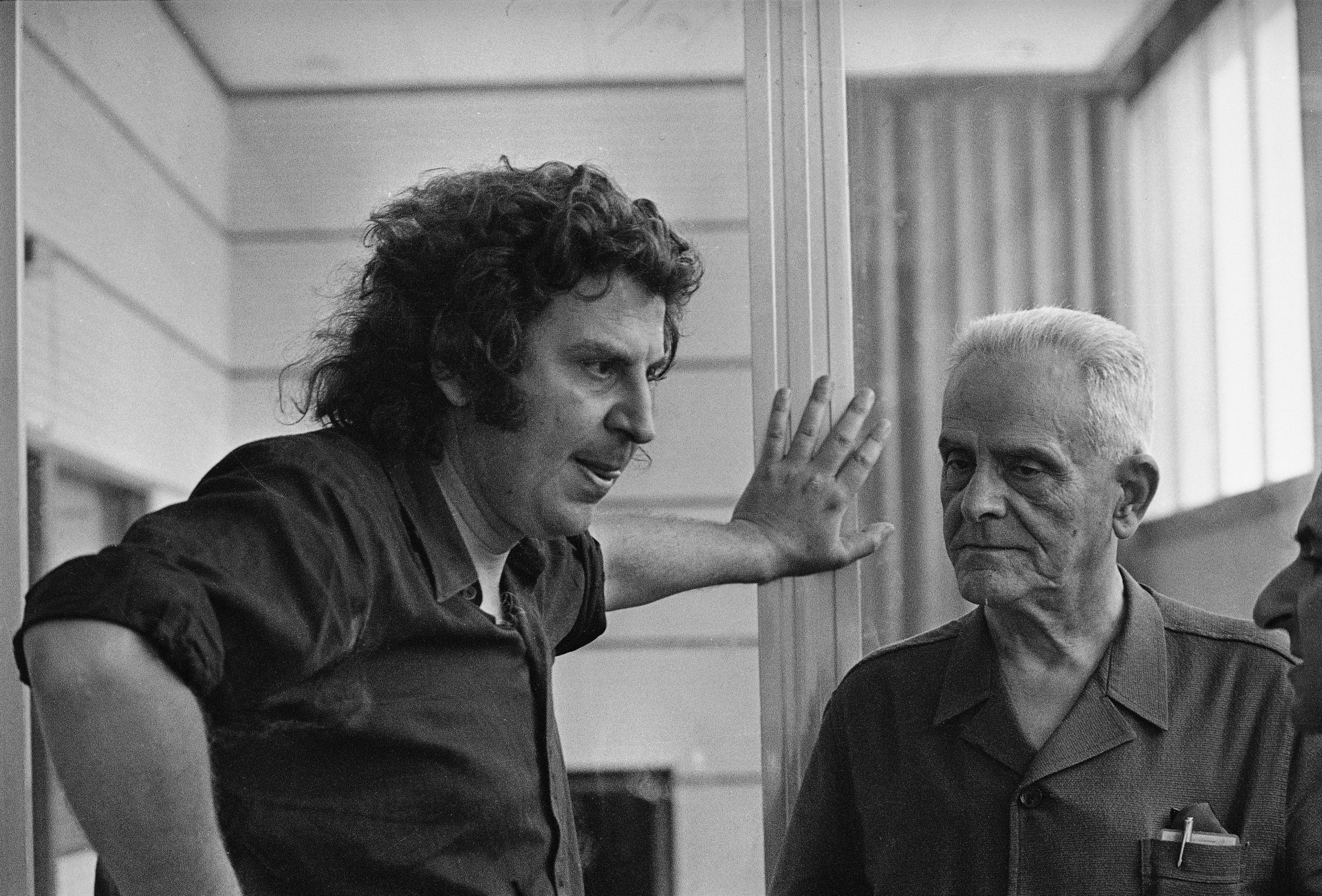 Greek composer Mikis Theodorakis (L), and his father Giorgios are pictured at a recording studio in Athens, Greece, Aug. 21, 1974. (AP Photo)