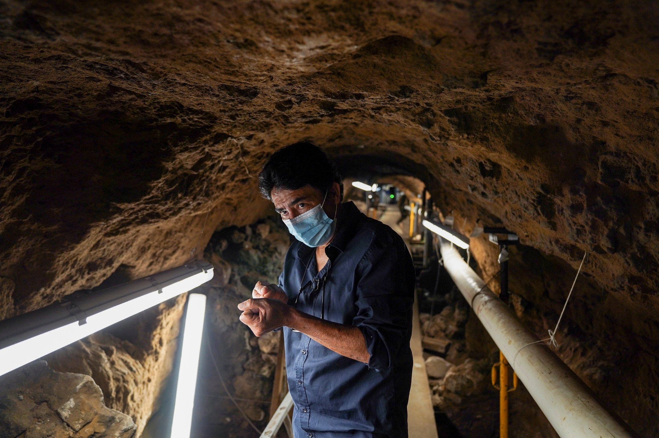 Archaeologist Sergio Gomez gestures inside a 2,000-year-old tunnel built under the ornate Feathered Serpent Pyramid, in the ruins of Teotihuacan, in San Juan Teotihuacan, Mexico, Aug. 12, 2021. (Reuters Photo)