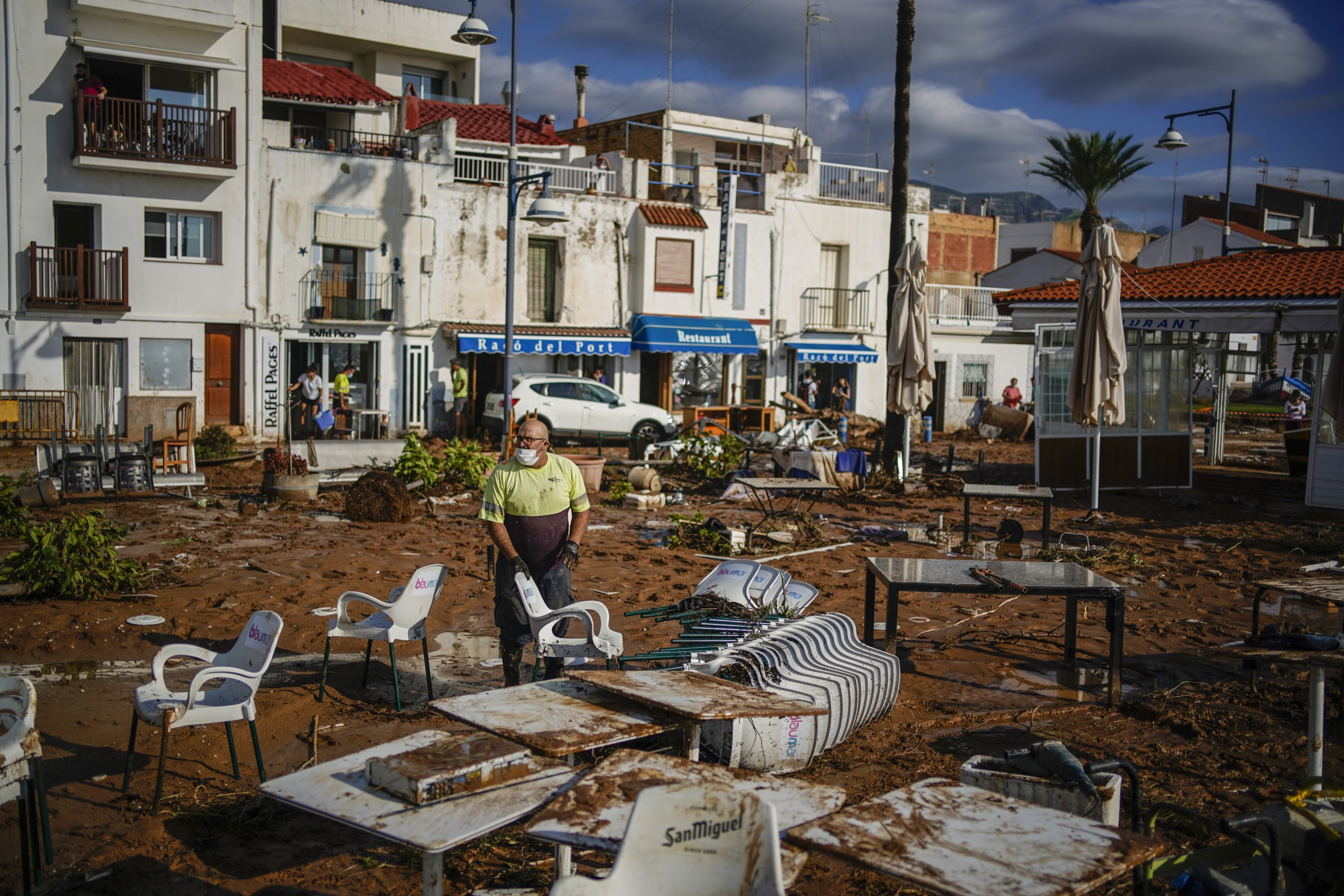 A municipality worker cleans up after flooding in a seaside town of Alcanar, in northeastern Spain, Sept. 2, 2021. (AP Photo)