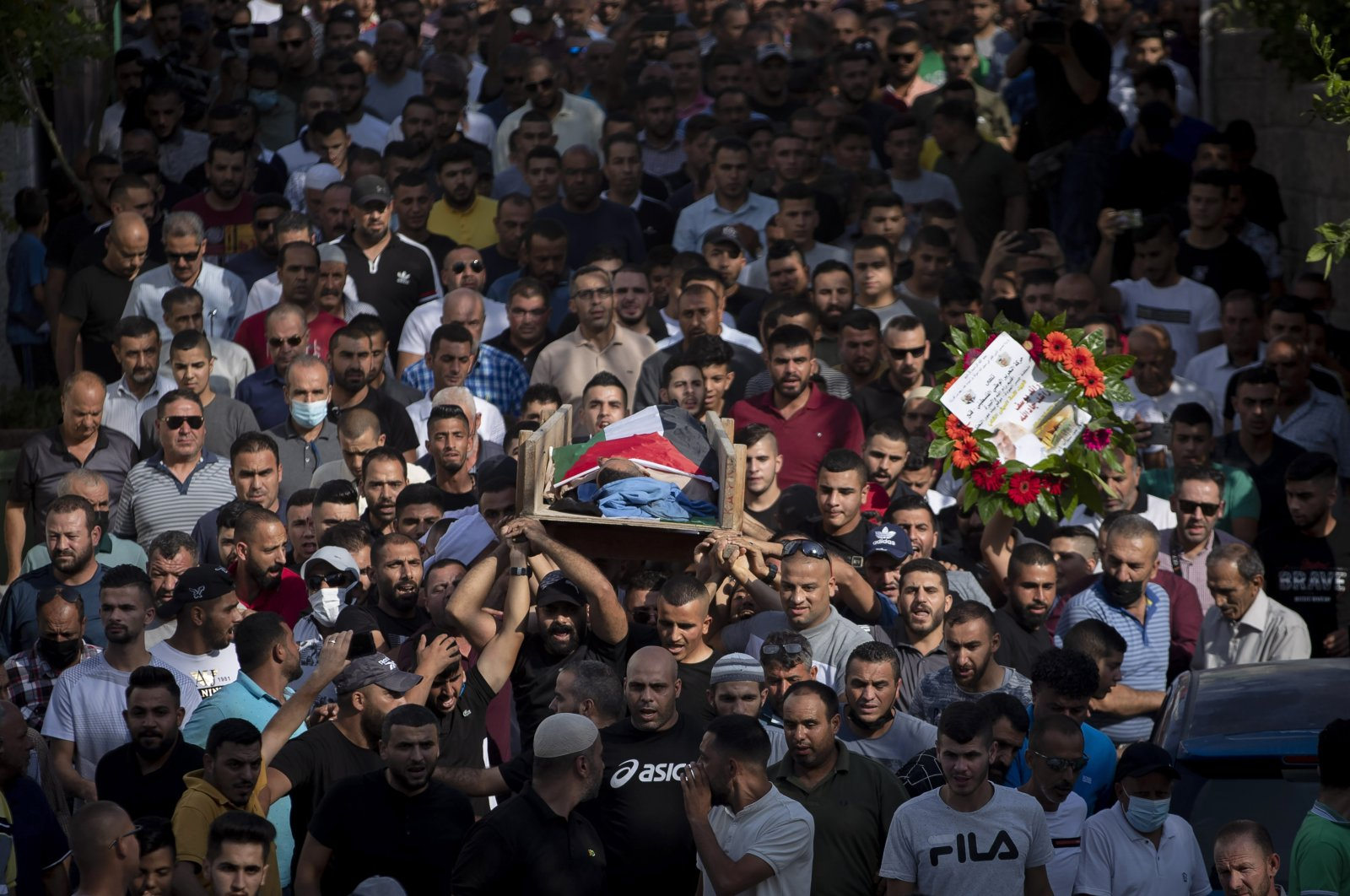 Palestinian mourners carry the body of a Palestinian citizen who was killed by Israeli forces at the western entrance of his village while returning from work in the early hours of Wednesday morning, during his funeral, in the West Bank village of Beit Ur al-Tahta, Palestine, Sept. 1, 2021. (AP Photo)
