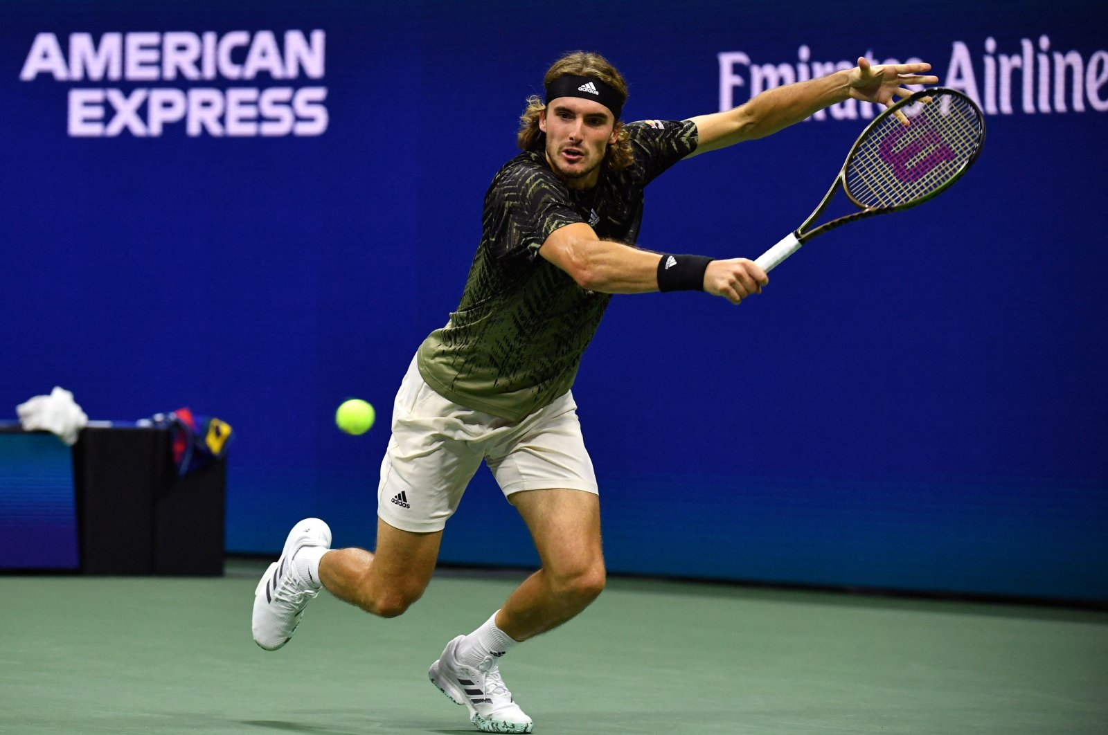 Greece's Stefanos Tsitsipas hits a return to France's Adrian Mannarino during their 2021 U.S. Open men's singles second-round match in New York, U.S., Sept. 1, 2021. (AFP Photo)