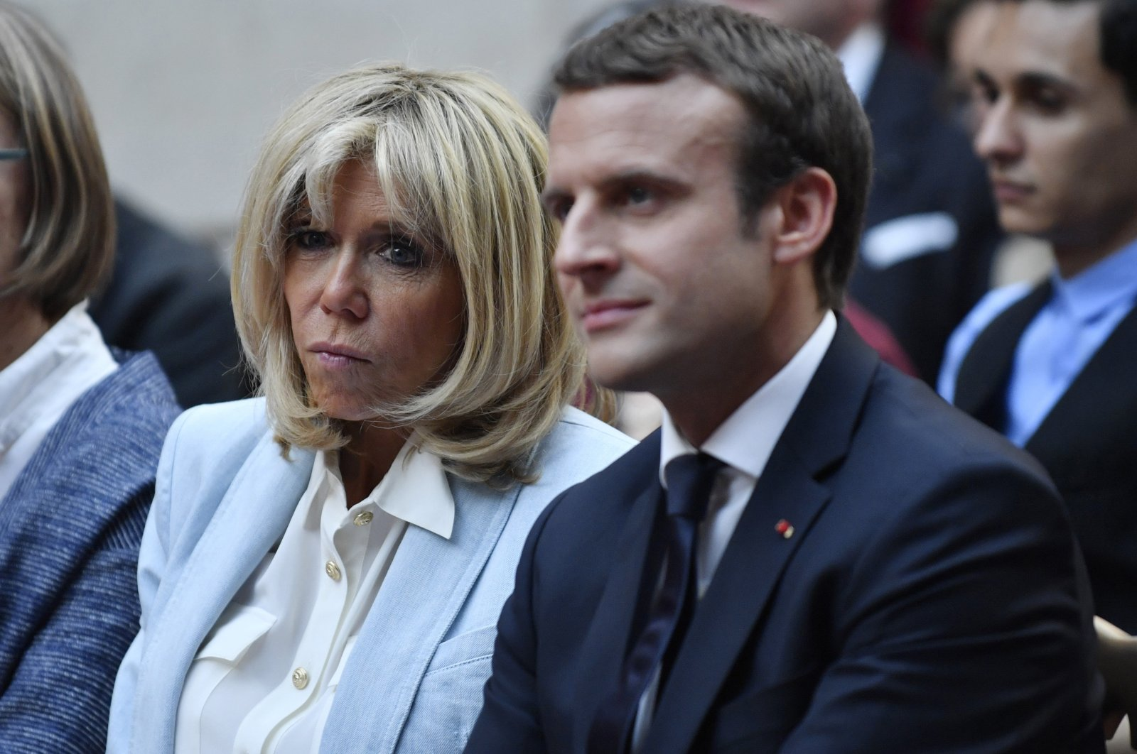 French First Lady Brigitte Macron and French President Emmanuel Macron attend a concert from the Pierre Claver Association at the Elysee Palace in Paris, France, on July 25, 2017. (AP Photo)