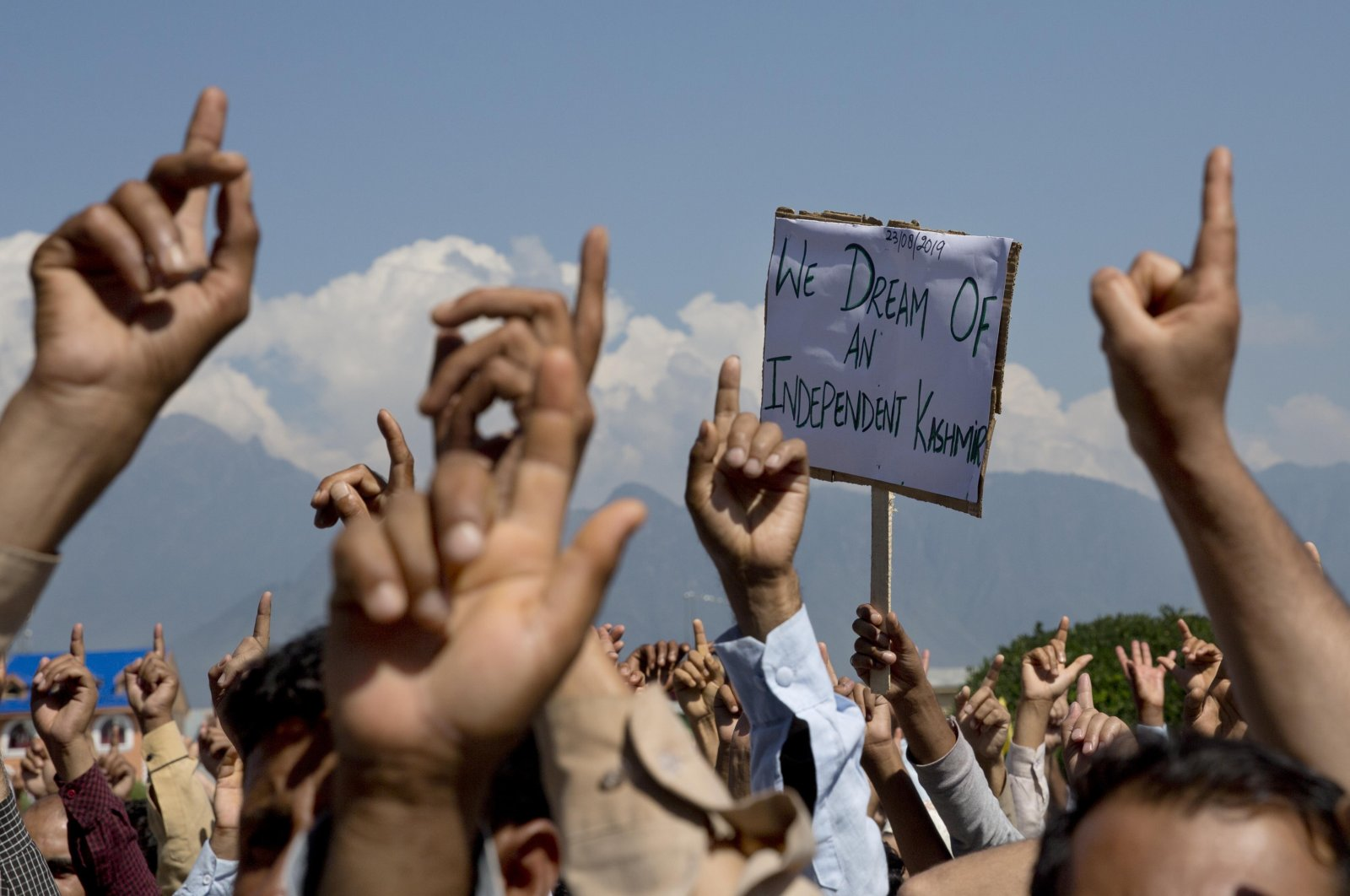Kashmiris shout freedom slogans during a protest against New Delhi's tightened grip on the disputed region, after Friday prayers on the outskirts of Srinagar, Indian controlled Kashmir, Aug. 23, 2019. (AP Photo)
