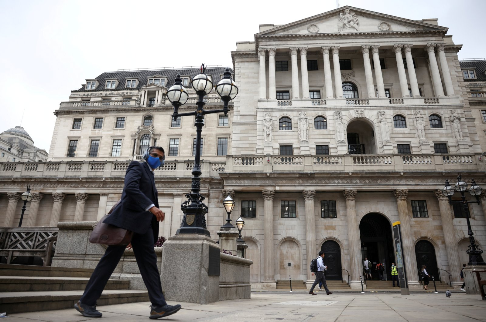 A person walks past the Bank of England in the City of London financial district, in London, U.K., June 11, 2021. (Reuters Photo)